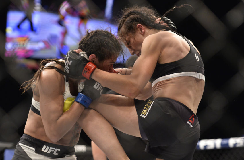 LAS VEGAS, NV - JULY 08: (R-L) Joanna Jedrzejczyk of Poland knees Claudia Gadelha of Brazil in their women's strawweight championship bout during The Ultimate Fighter Finale event at MGM Grand Garden Arena on July 8, 2016 in Las Vegas, Nevada. (Photo by Brandon Magnus/Zuffa LLC/Zuffa LLC via Getty Images)