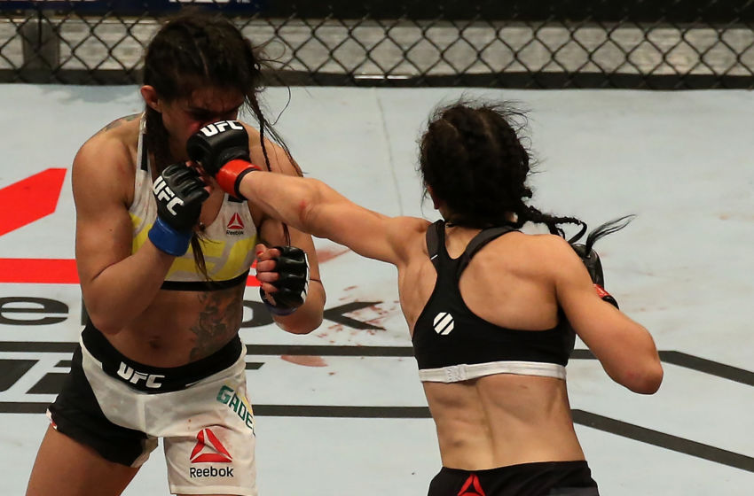 LAS VEGAS, NV - JULY 08: (R-L) Joanna Jedrzejczyk of Poland punches Claudia Gadelha of Brazil in their UFC women's strawweight championship bout during The Ultimate Fighter Finale event at MGM Grand Garden Arena on July 8, 2016 in Las Vegas, Nevada. (Photo by Ed Mulholland/Zuffa LLC/Zuffa LLC via Getty Images)