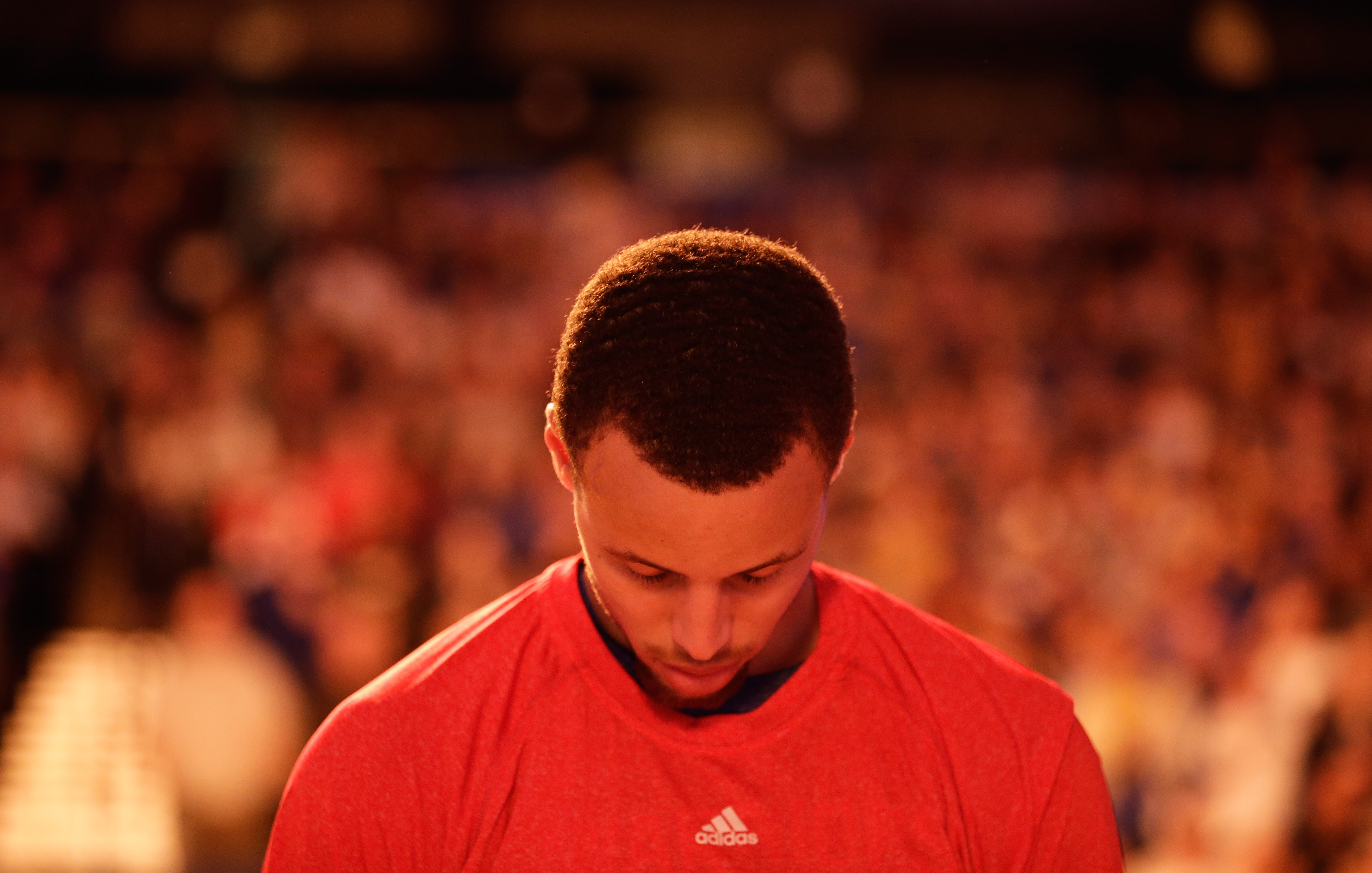 OAKLAND, CA - JANUARY 27: Stephen Curry #30 of the Golden State Warriors stands on the court for the National Anthem before their game against the Chicago Bulls at ORACLE Arena on January 27, 2015 in Oakland, California. NOTE TO USER: User expressly acknowledges and agrees that, by downloading and or using this photograph, User is consenting to the terms and conditions of the Getty Images License Agreement. (Photo by Ezra Shaw/Getty Images)