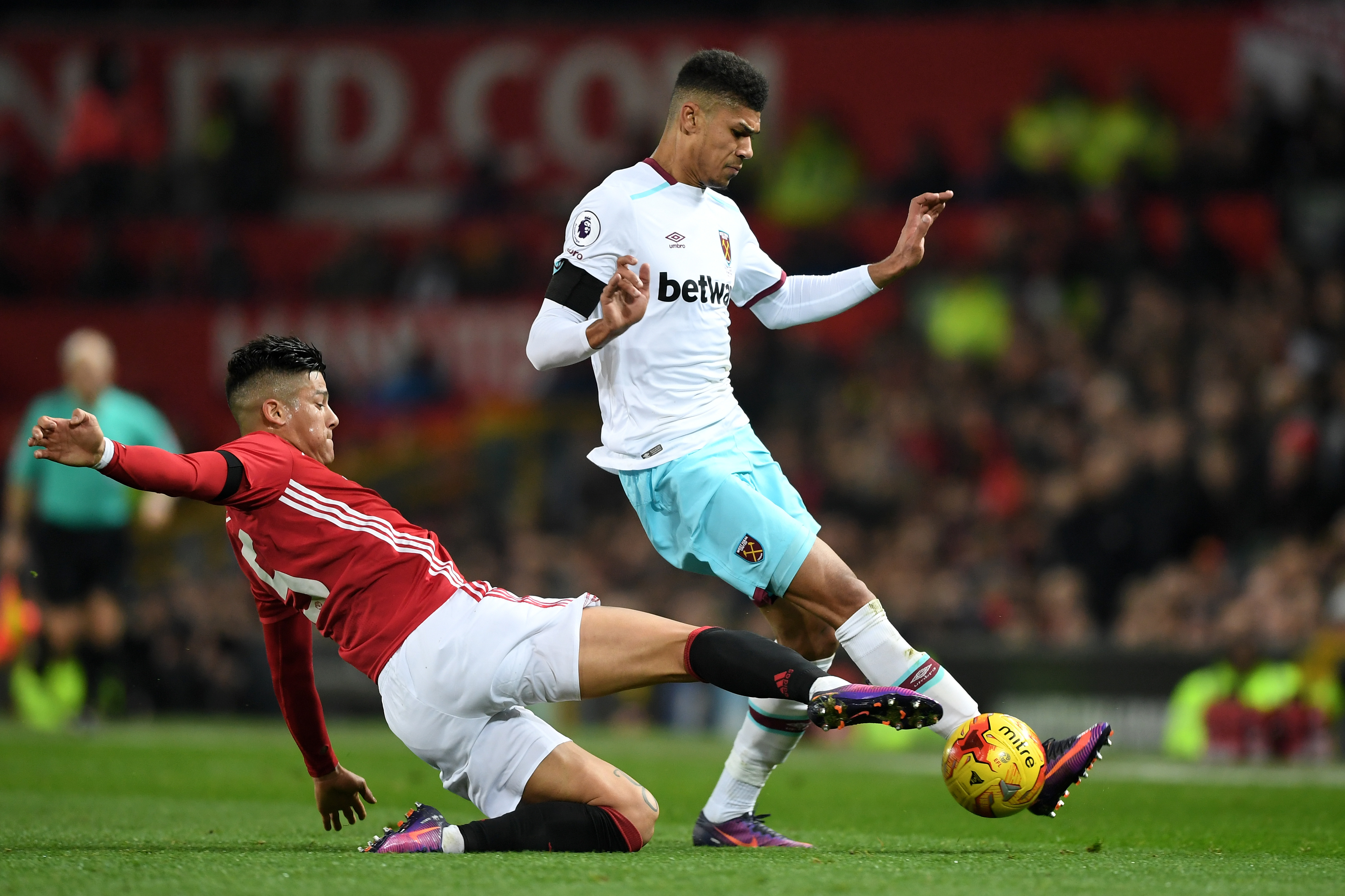 M Ashley Fletcher of West Ham United is tackled by Marcos Rojo of Manchester United
