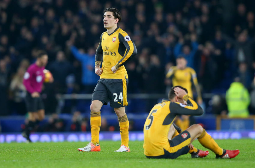 dejected arsenal players lament loss to everton