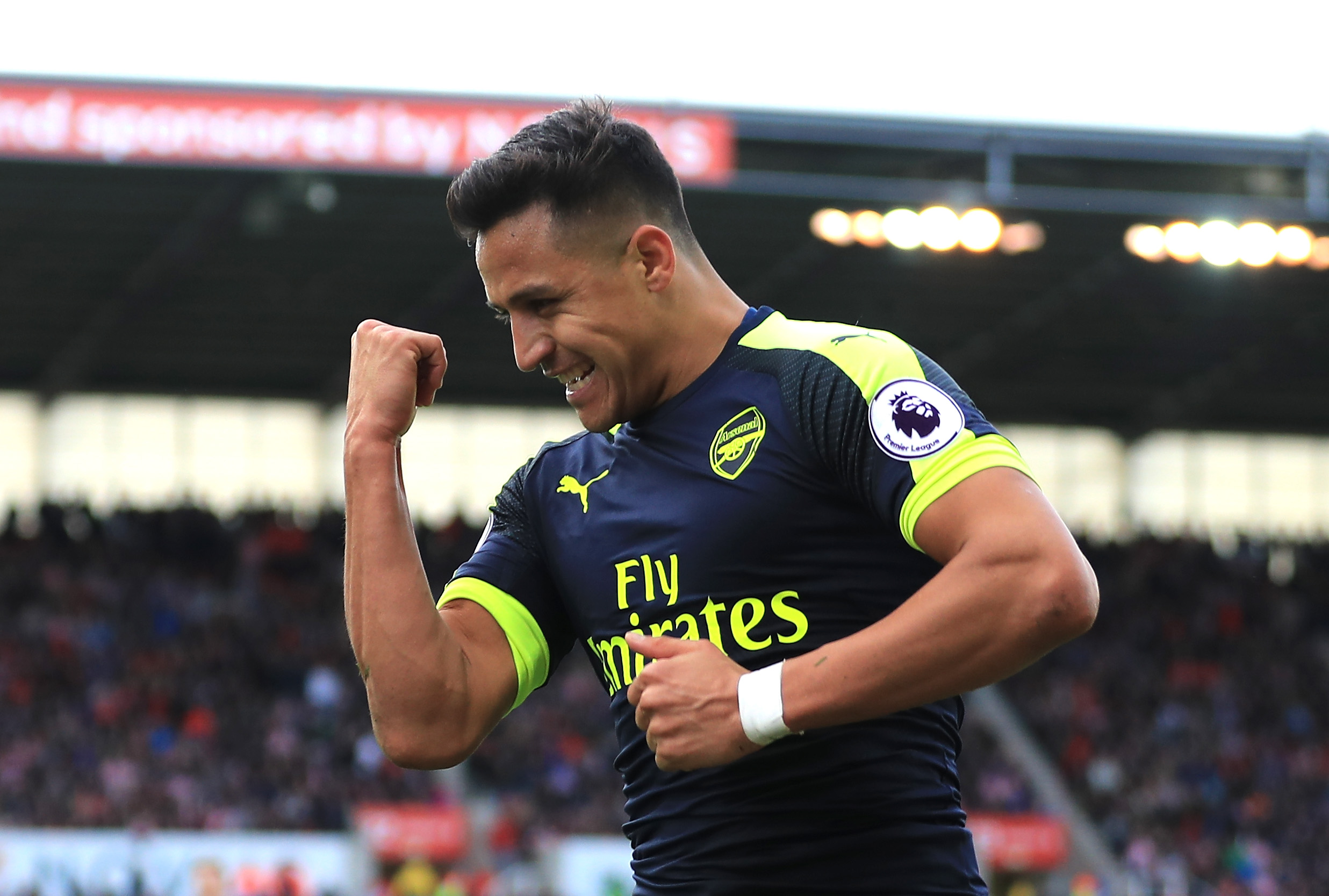 Sanchez keeps Arsenal in top four fight