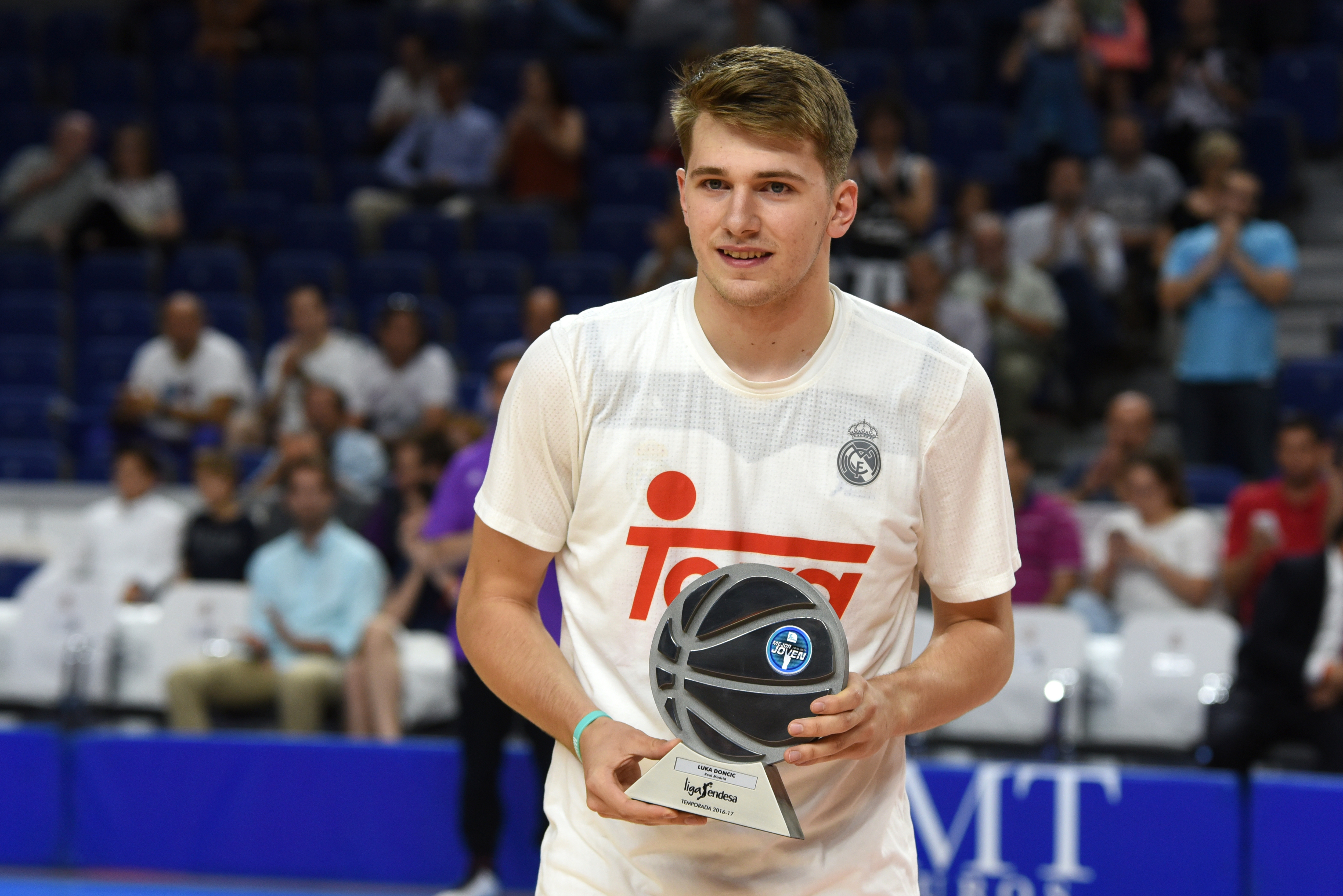 688050912-luca-doncic-of-real-madrid-poses-with-his-trophy-of-best.jpg