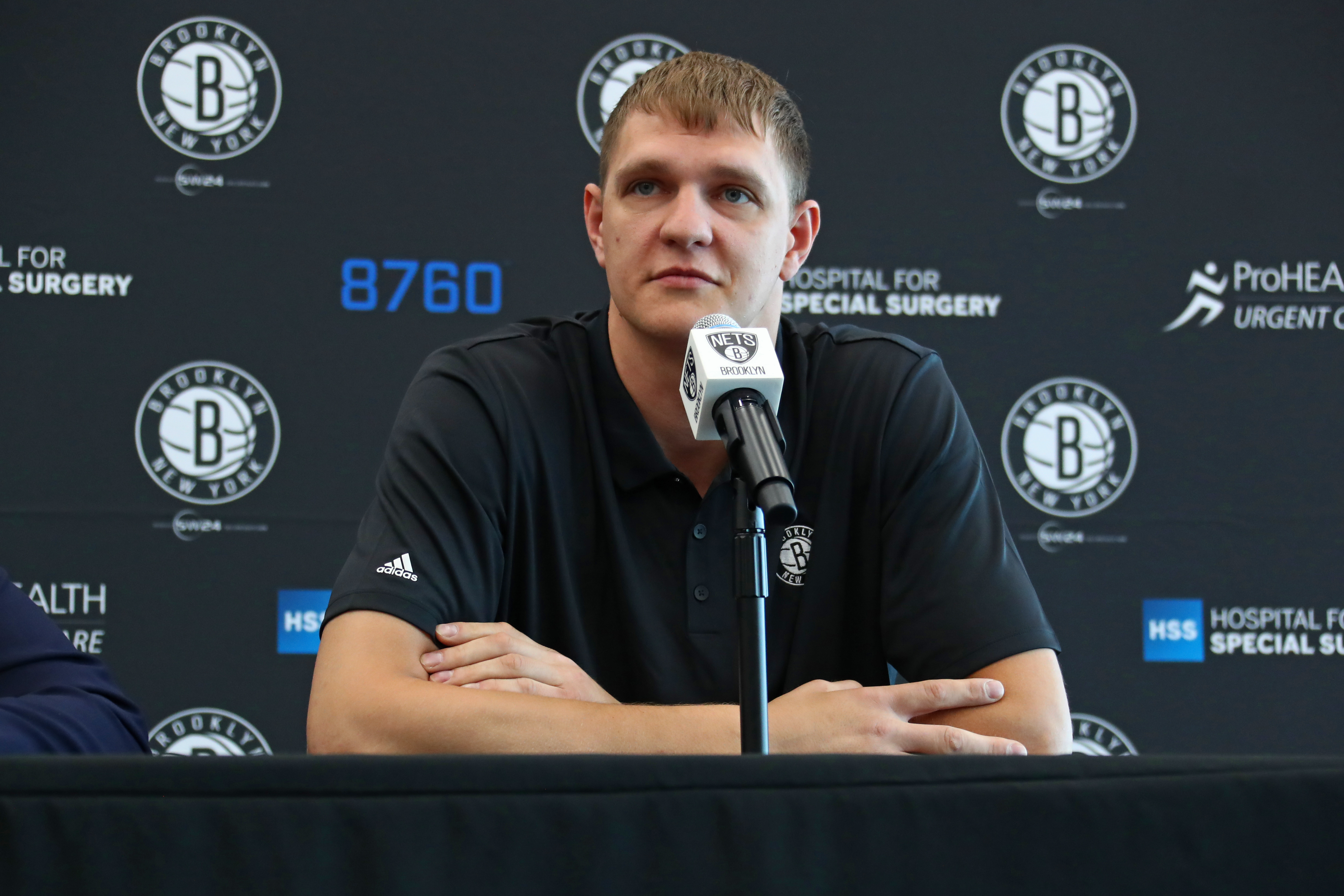 801452870-brooklyn-nets-introduce-dangelo-russell-and-timofey-mozgov-during-a-press-conference.jpg