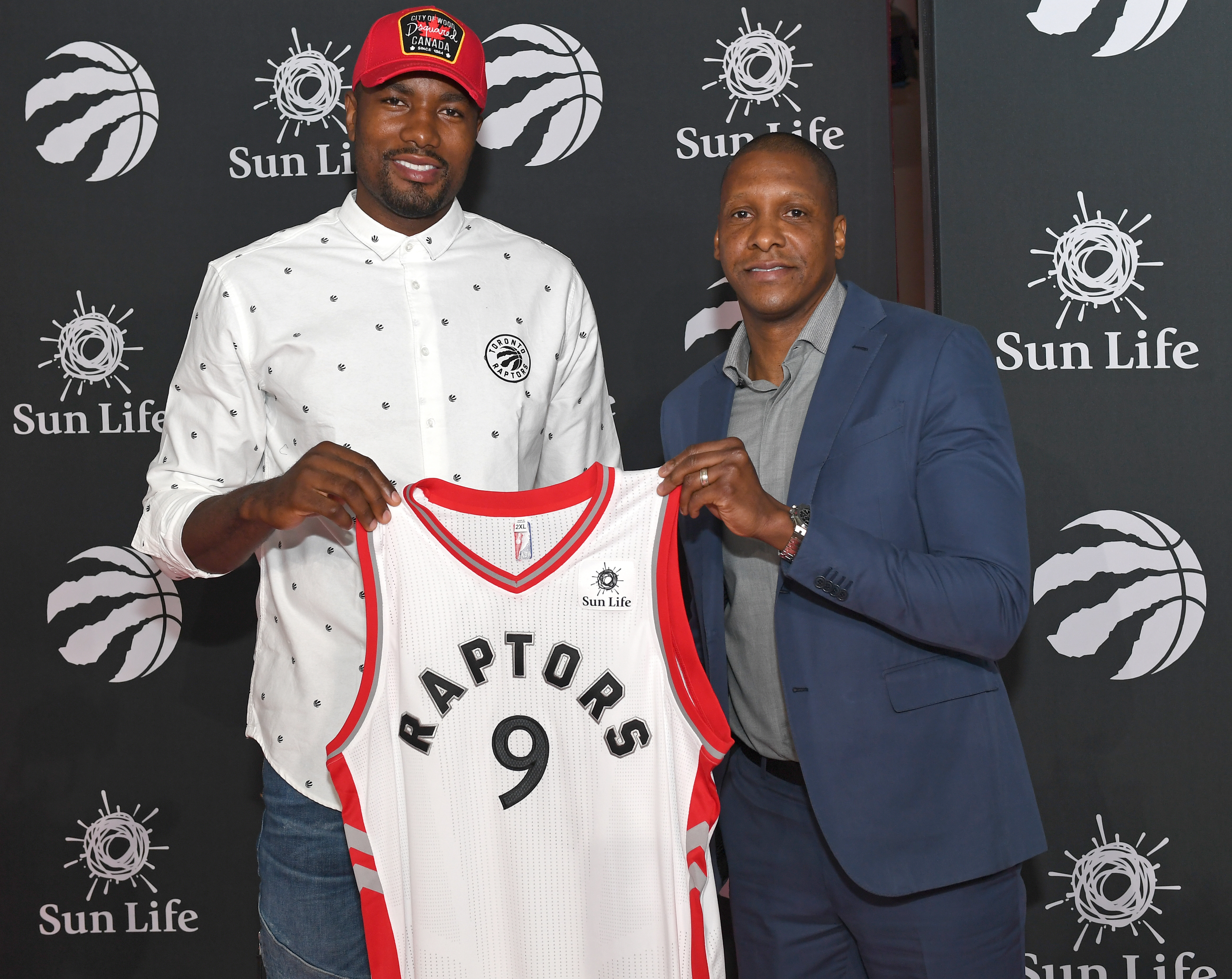 812599238-toronto-raptors-announce-the-re-signing-of-serge-ibaka-and-kyle-lowry.jpg