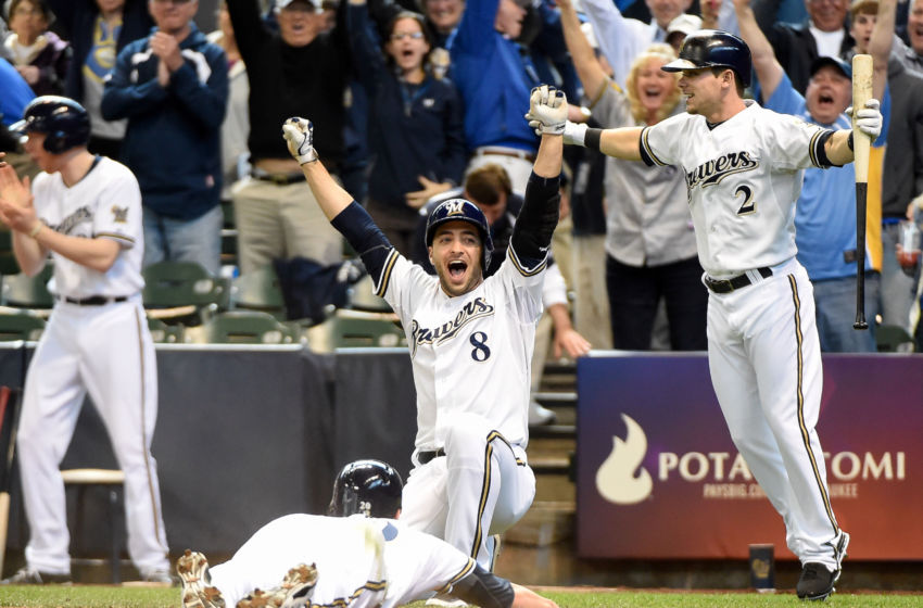 May 15, 2014; Milwaukee, WI, USA; Milwaukee Brewers right fielder Ryan Braun (8) and second baseman Scooter Gennett (2) celebrate as catcher Jonathan Lucroy (bottom) scores the winning run in the ninth inning as the Brewers beat the Pittsburgh Pirates 4-3 at Miller Park. Mandatory Credit: Benny Sieu-USA TODAY Sports