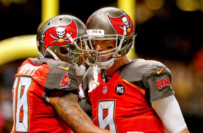 Oct 5, 2014; New Orleans, LA, USA; Tampa Bay Buccaneers quarterback Mike Glennon (8) celebrates a touchdown with wide receiver Louis Murphy (18) during the second quarter of a game against the New Orleans Saints at Mercedes-Benz Superdome. Mandatory Credit: Derick E. Hingle-USA TODAY Sports