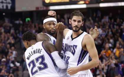 Nov 15, 2014; Sacramento, CA, USA; Sacramento Kings guard Ben McLemore (23), center DeMarcus Cousins (15) and forward Omri Casspi (18) celebrate after the win against the San Antonio Spurs at Sleep Train Arena.The Sacramento Kings defeated the San Antonio Spurs 94-91. Mandatory Credit: Kelley L Cox-USA TODAY Sports