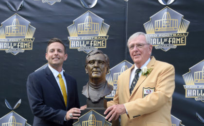 Aug 8, 2015; Canton, OH, USA; Ron Wolf (right) poses with bust and son and presenter Eliot Wolf during the 2015 Pro Football Hall of Fame enshrinement at Tom Benson Hall of Fame Stadium. Mandatory Credit: Kirby Lee-USA TODAY Sports