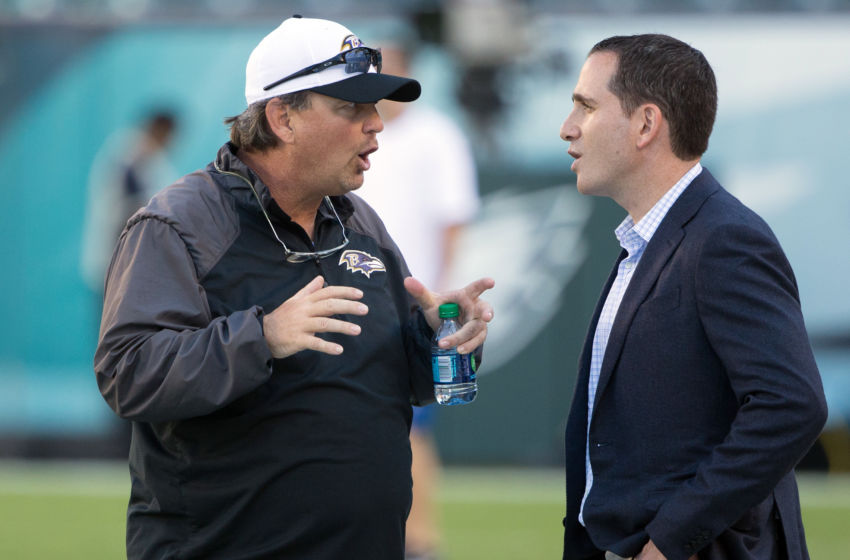 Aug 22, 2015; Philadelphia, PA, USA; Baltimore Ravens quarterback coach Marty Mornhinweg (left) talks with Philadelphia Eagles vice president of football operations Howie Roseman (right) during warm ups before a game at Lincoln Financial Field. Mandatory Credit: Bill Streicher-USA TODAY Sports