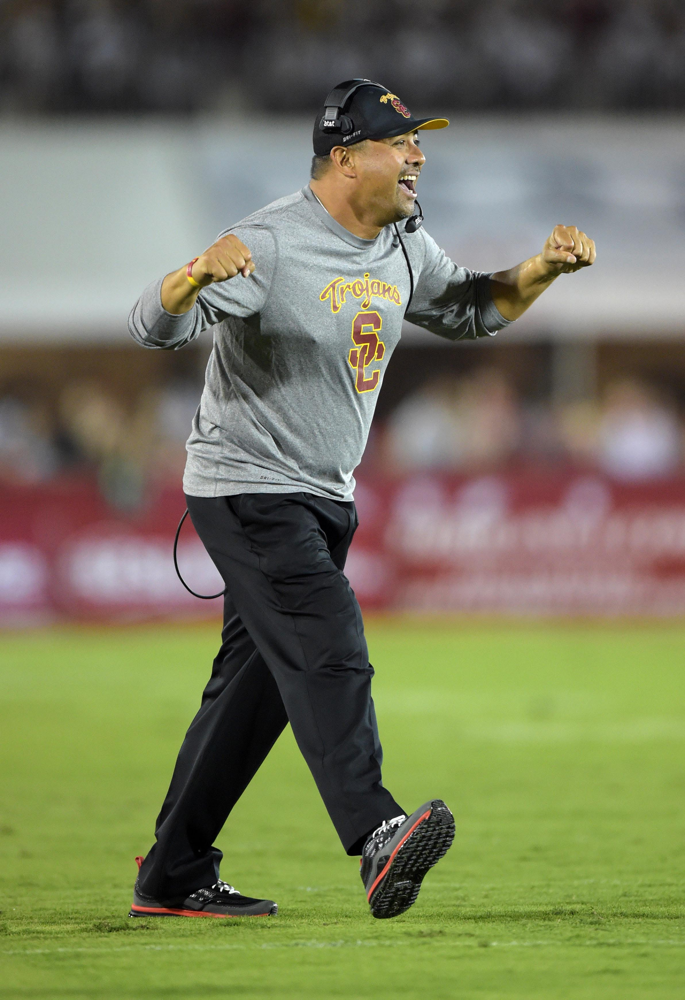 Sep 5, 2015; Los Angeles, CA, USA; Southern California running backs coach Johnny Nansen celebrates after a Trojans touchdown against the Arkansas State Red Wolves at Los Angeles Memorial Coliseum. Mandatory Credit: Kirby Lee-USA TODAY Sports