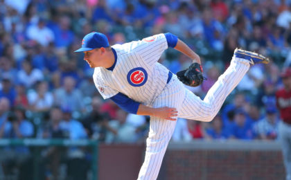 Sep 6, 2015; Chicago, IL, USA; Chicago Cubs relief pitcher Trevor Cahill (53) delivers a pitch during the ninth inning against the Arizona Diamondbacks at Wrigley Field. Chicago won 6-4. Mandatory Credit: Dennis Wierzbicki-USA TODAY Sports