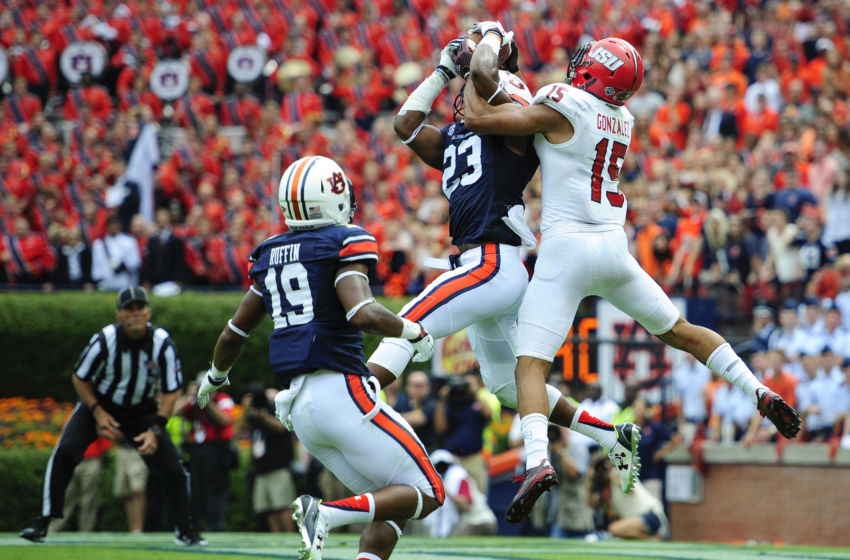 Sep 12, 2015; Auburn, AL, USA; Auburn Tigers defensive back Johnathan Ford (23) intercepts a Jacksonville State Gamecocks pass in the end zone intended for Jacksonville State Gamecocks wide receiver Ruben Gonzalez (15) during the third quarter at Jordan Hare Stadium. Mandatory Credit: Shanna Lockwood-USA TODAY Sports
