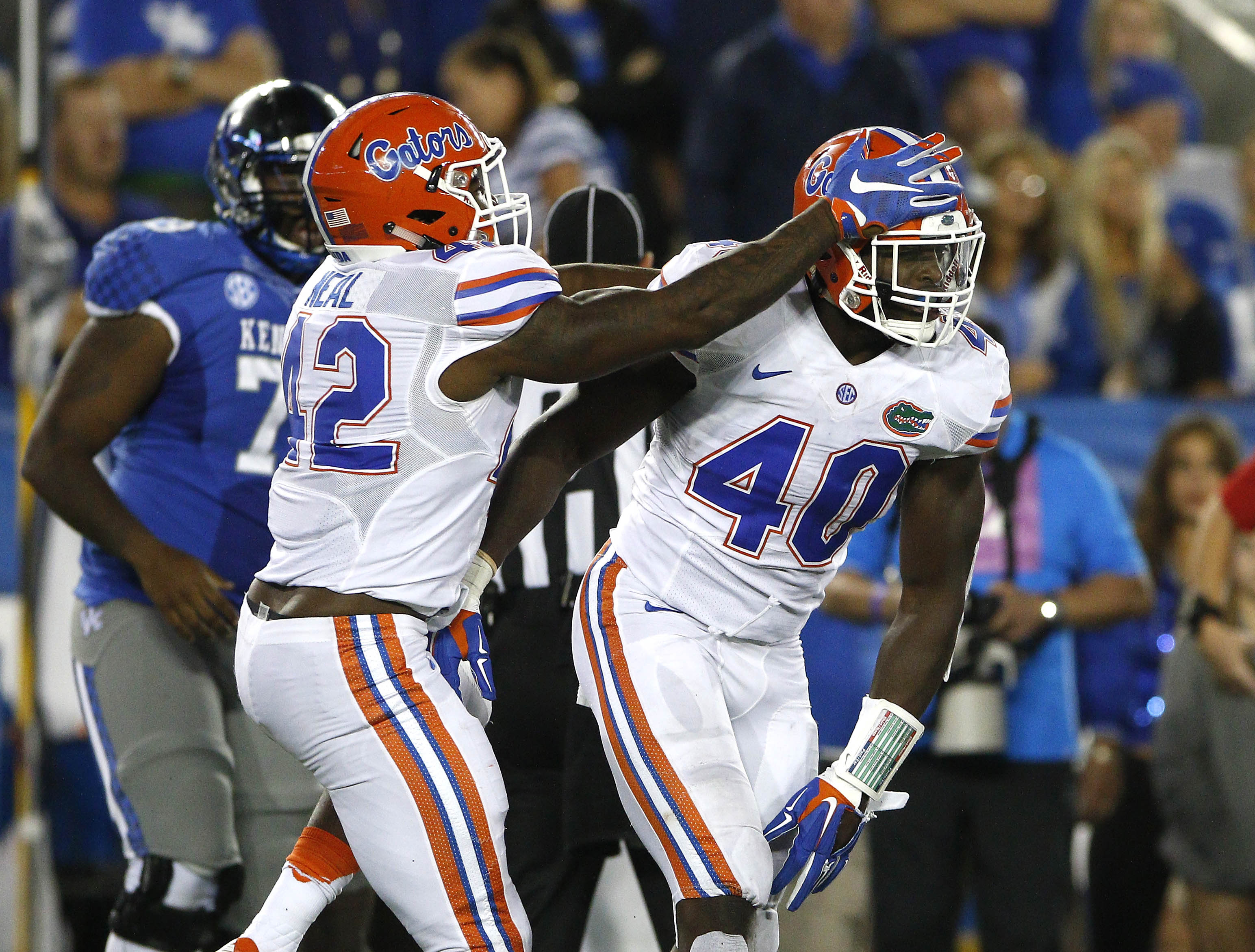 Sep 19, 2015; Lexington, KY, USA; Florida Gators defensive back Keanu Neal (42) and linebacker Jarrad Davis (40) celebrate during the game against the Kentucky Wildcats at Commonwealth Stadium. Florida defeated Kentucky 14-9. Mandatory Credit: Mark Zerof-USA TODAY Sports