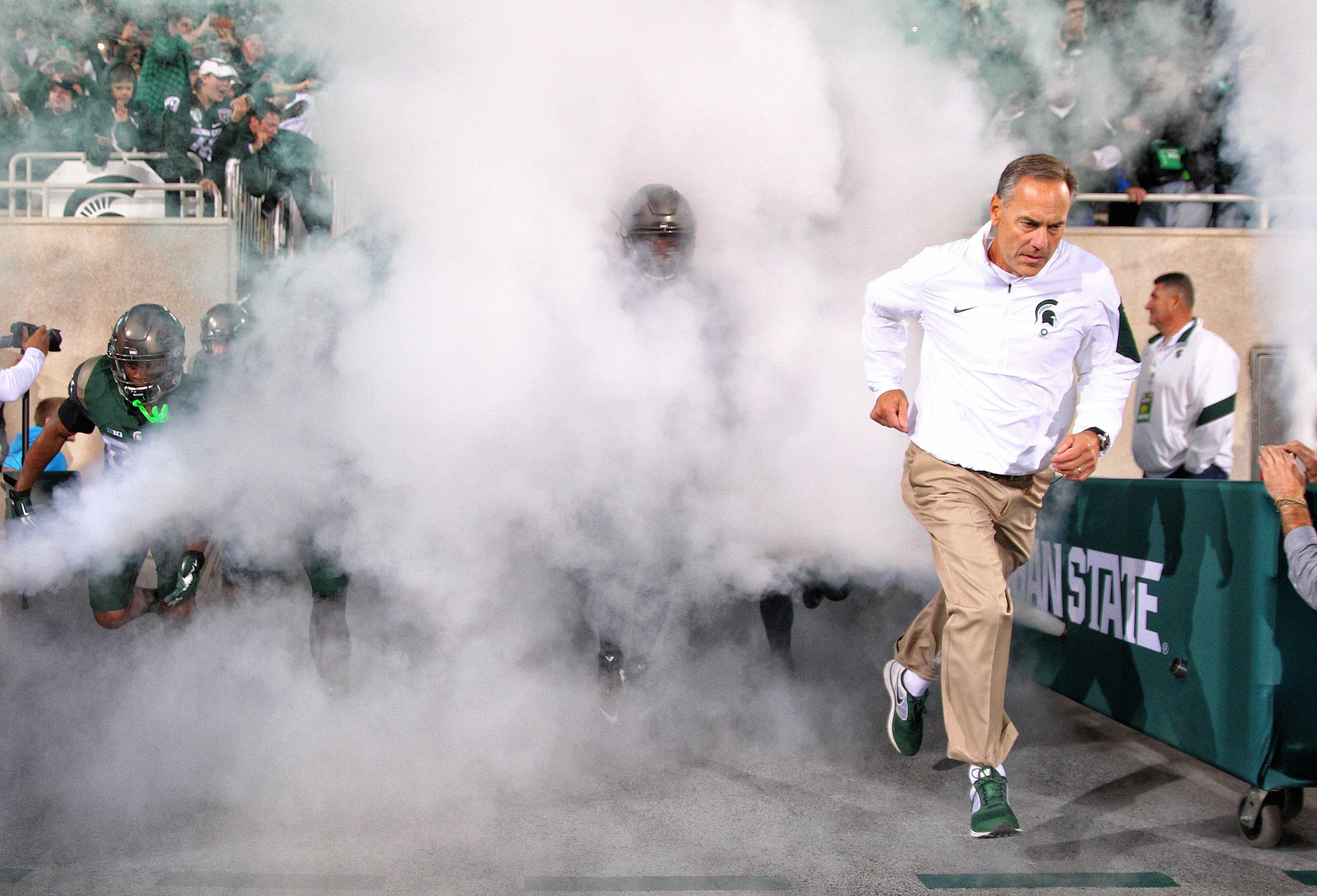 Sep 12, 2015; East Lansing, MI, USA; Michigan State Spartans head coach Mark Dantonio brings his team onto the flied prior to a game at Spartan Stadium. Mandatory Credit: Mike Carter-USA TODAY Sports