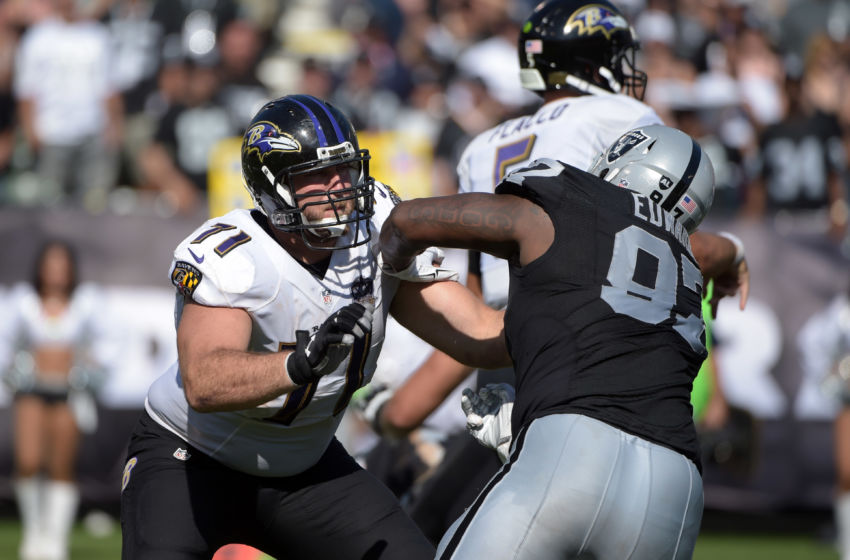 Sep 20, 2015; Oakland, CA, USA; Baltimore Ravens right tackle Rick Wagner (71) defends against Oakland Raiders defensive end Mario Edwards Jr. (97) at O.co Coliseum. The Raiders defeated the Ravens 37-33. Mandatory Credit: Kirby Lee-USA TODAY Sports