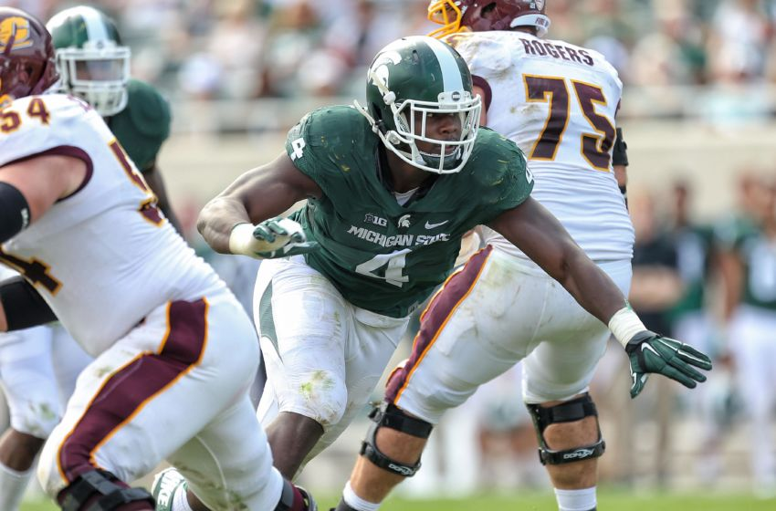 Sep 26, 2015; East Lansing, MI, USA; Michigan State Spartans defensive lineman Malik McDowell (4) breaks though the Central Michigan offensive line during the 2nd half of a game at Spartan Stadium. MSU won 30-10. Mandatory Credit: Mike Carter-USA TODAY Sports