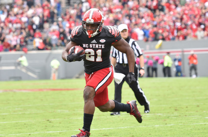 Oct 3, 2015; Raleigh, NC, USA; North Carolina State Wolfpack running back Matthew Dayes (21) scores a touchdown during the second quarter against the Louisville Cardinals at Carter Finley Stadium. Mandatory Credit: Evan Pike-USA TODAY Sports