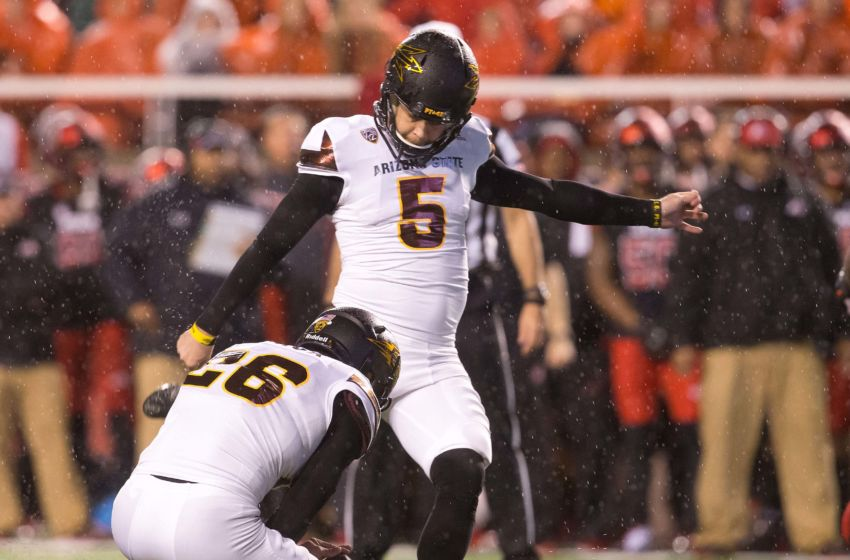 Oct 17, 2015; Salt Lake City, UT, USA; Arizona State Sun Devils place kicker Zane Gonzalez (5) kicks the ball as punter Matt Haack (26) holds during the second half against the Utah Utes at Rice-Eccles Stadium. Utah won 34-18. Mandatory Credit: Russ Isabella-USA TODAY Sports