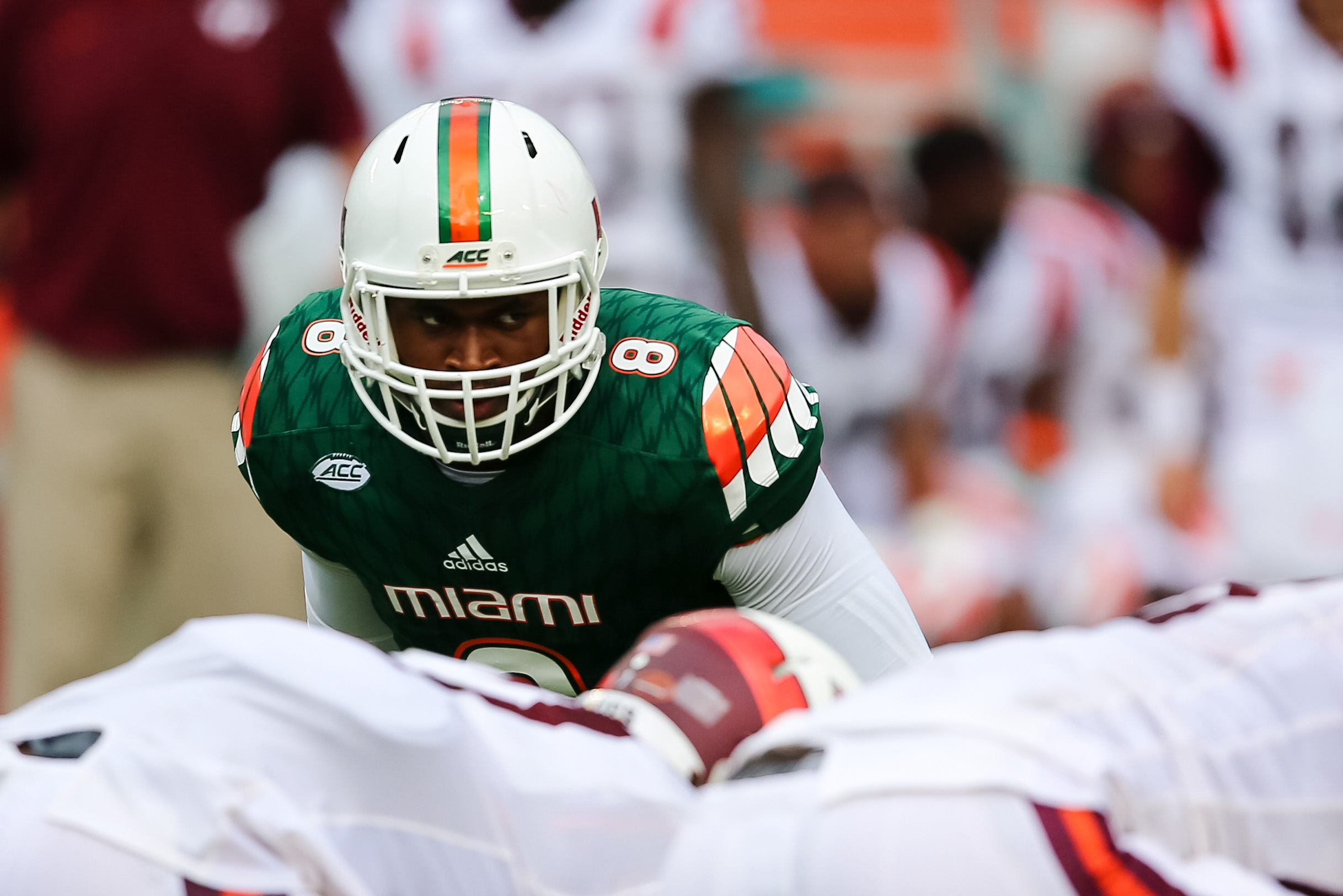 Oct 17, 2015; Miami Gardens, FL, USA; Miami Hurricanes defensive lineman Al-Quadin Muhammad (8) lines up at the line of scrimmage against Virginia Tech Hokies during the first half at Sun Life Stadium. Miami won 30-20. Mandatory Credit: Steve Mitchell-USA TODAY Sports