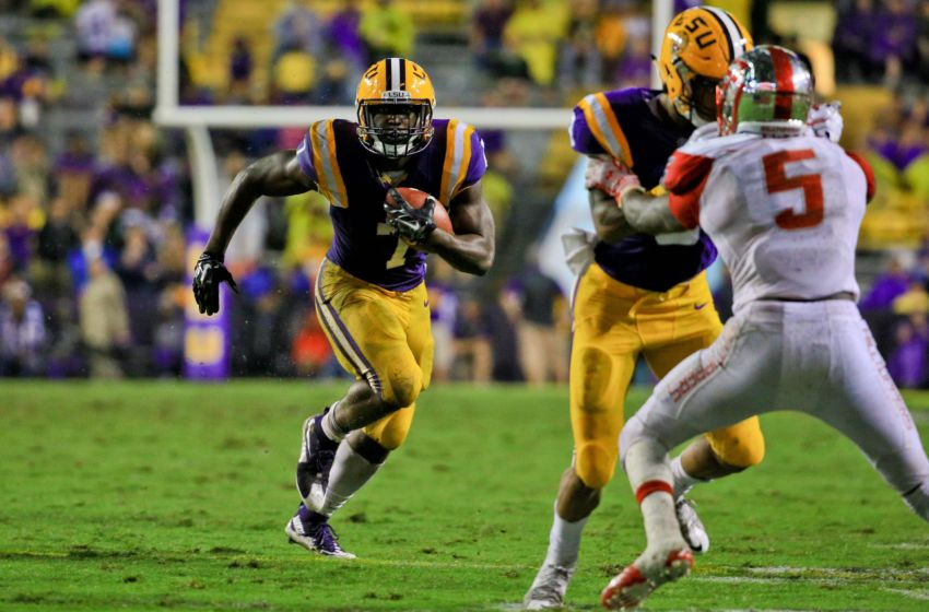 Oct 24, 2015; Baton Rouge, LA, USA; LSU Tigers running back Leonard Fournette (7) runs against the Western Kentucky Hilltoppers during the third quarter of a game at Tiger Stadium. Mandatory Credit: Derick E. Hingle-USA TODAY Sports