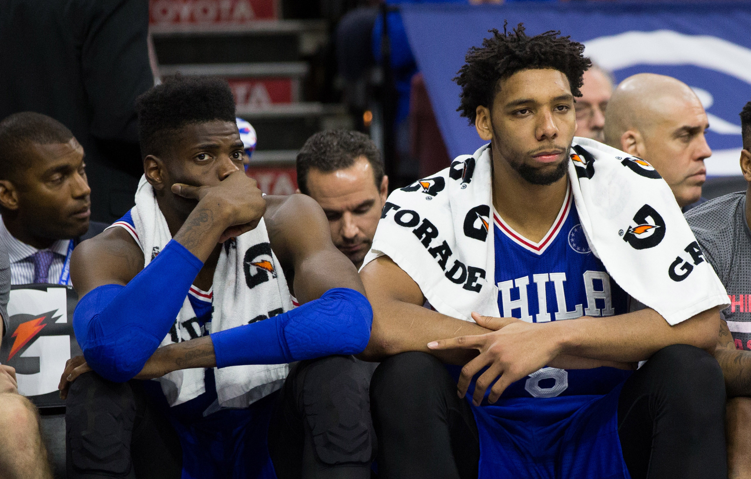 Oct 30, 2015; Philadelphia, PA, USA; Philadelphia 76ers center Nerlens Noel (left) and center Jahlil Okafor (right) watch from the bench during the final minutes of a game against the Utah Jazz at Wells Fargo Center. The Utah Jazz won 99-71. Mandatory Credit: Bill Streicher-USA TODAY Sports