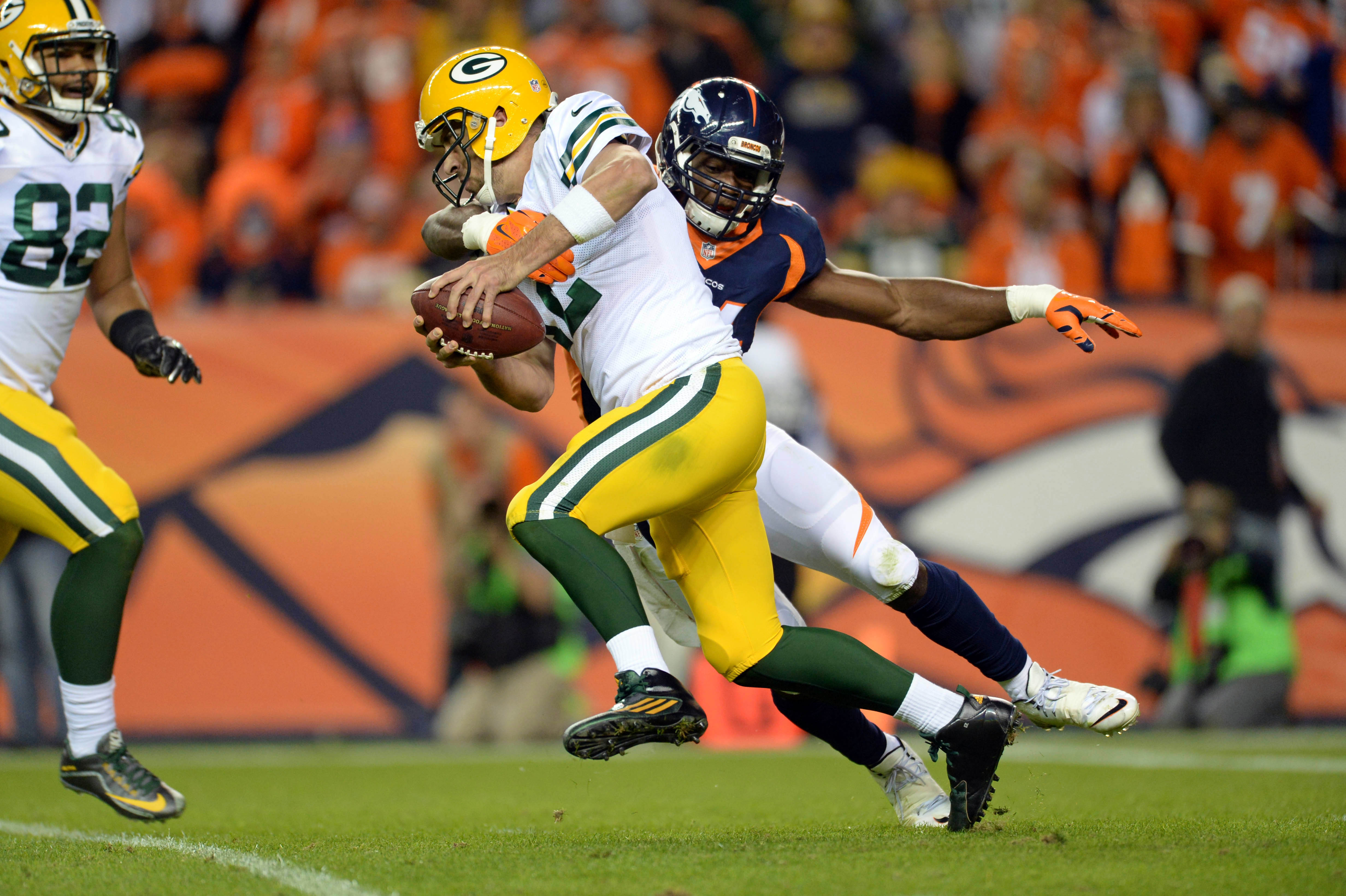 Nov 1, 2015; Denver, CO, USA; Denver Broncos outside linebacker DeMarcus Ware (94) sacks Green Bay Packers quarterback Aaron Rodgers (12) in the fourth quarter at Sports Authority Field at Mile High. The Broncos defeated the Packer 29-10. Mandatory Credit: Ron Chenoy-USA TODAY Sports