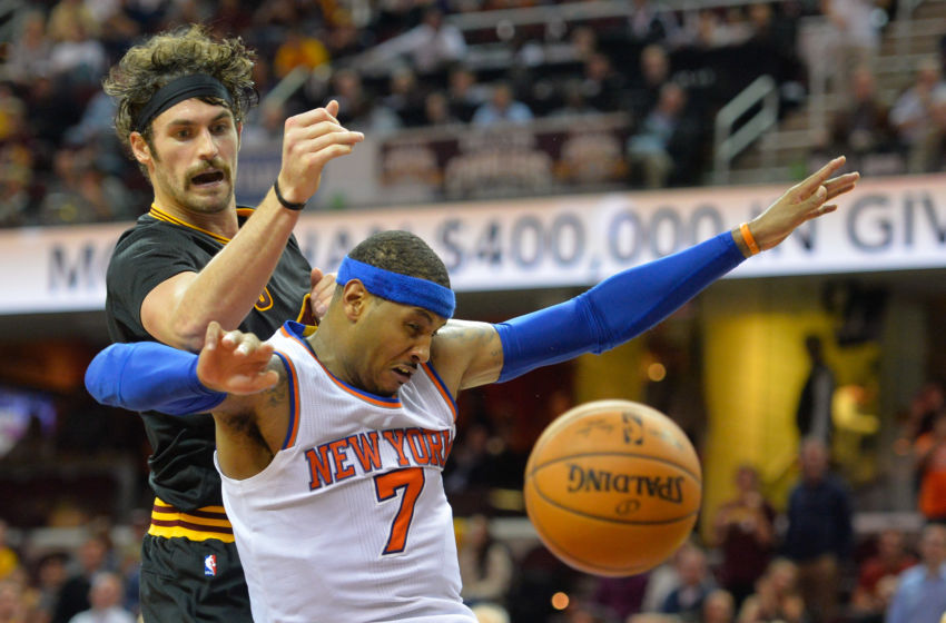 Nov 4, 2015; Cleveland, OH, USA; New York Knicks forward Carmelo Anthony (7) and Cleveland Cavaliers forward Kevin Love (0) battle for a rebound during a game at Quicken Loans Arena. Cleveland won 96-86. Mandatory Credit: David Richard-USA TODAY Sports