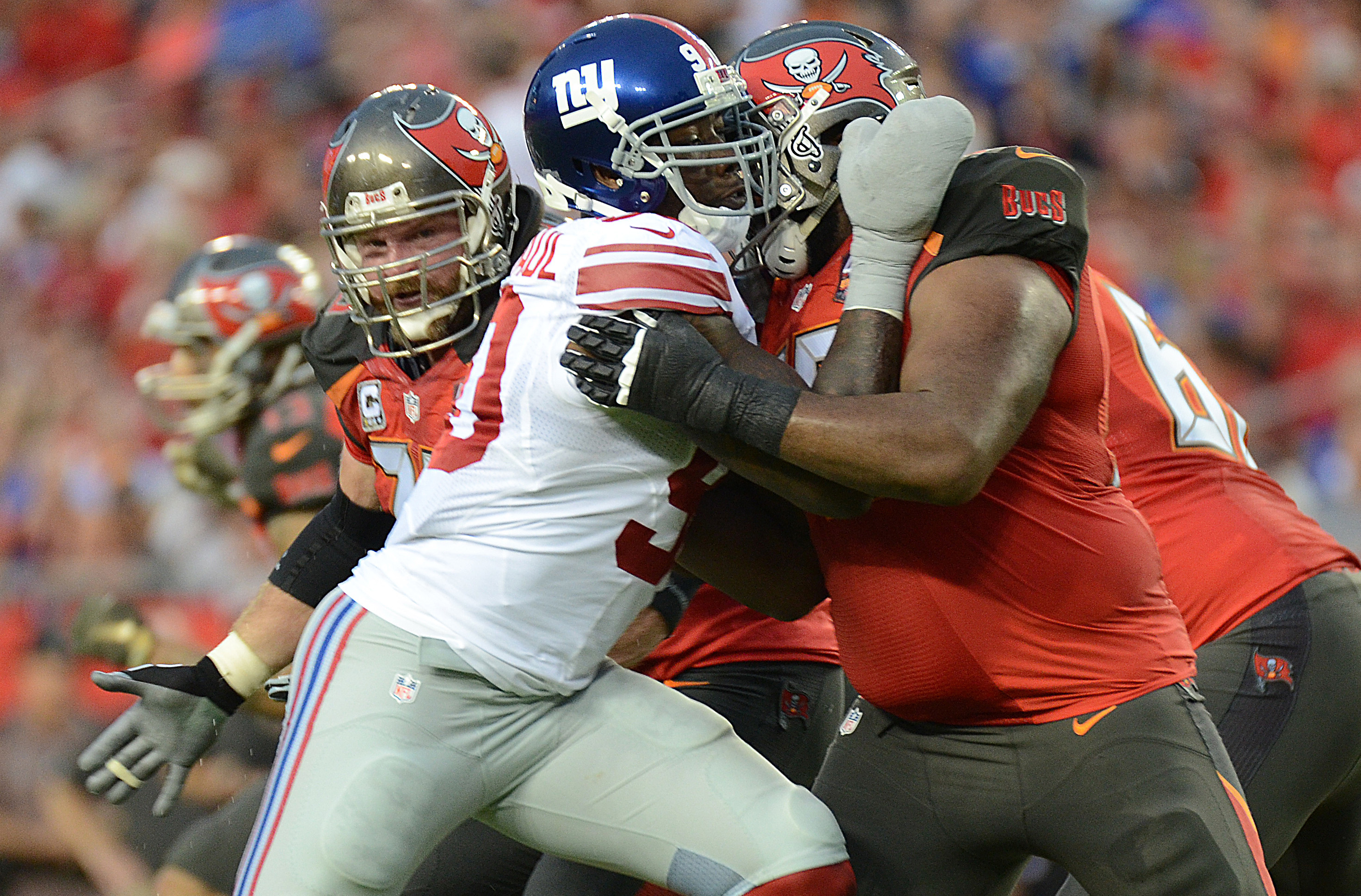 Nov 8, 2015; Tampa, FL, USA; New York Giants defensive lineman Jason Pierre-Paul (90) rushes the passer in the first half against theTampa Bay Buccaneers at Raymond James Stadium. The New York Giants defeated the Tampa Bay Buccaneers 32-18. Mandatory Credit: Jonathan Dyer-USA TODAY Sports