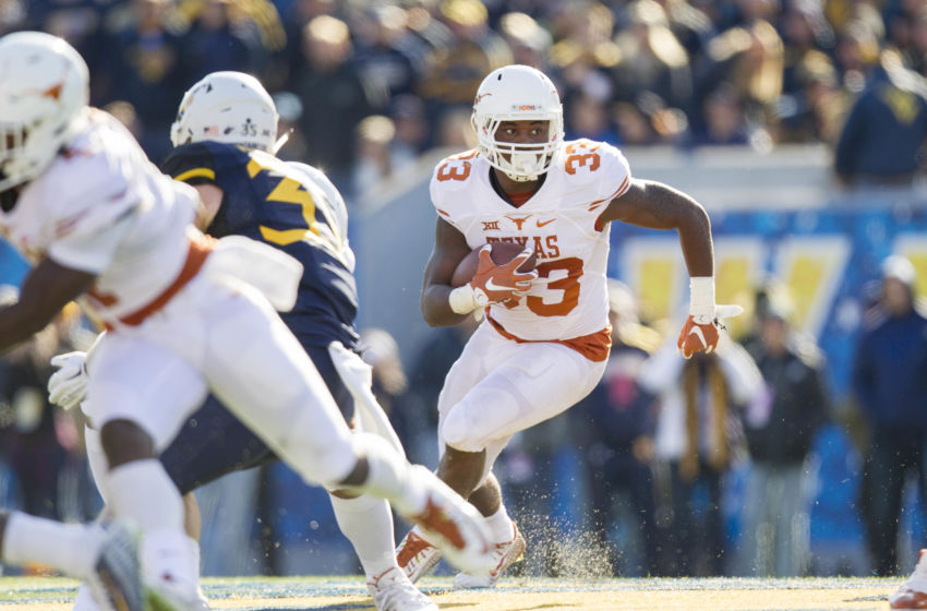 Nov 14, 2015; Morgantown, WV, USA; Texas Longhorns running back D'Onta Foreman runs the ball during the third quarter against the West Virginia Mountaineers at Milan Puskar Stadium. Mandatory Credit: Ben Queen-USA TODAY Sports