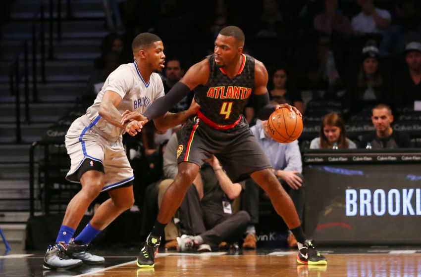 Nov 17, 2015; Brooklyn, NY, USA; Atlanta Hawks forward Paul Millsap (4) dribbles the ball as Brooklyn Nets forward Joe Johnson (7) defends during the first quarter at Barclays Center. Mandatory Credit: Anthony Gruppuso-USA TODAY Sports