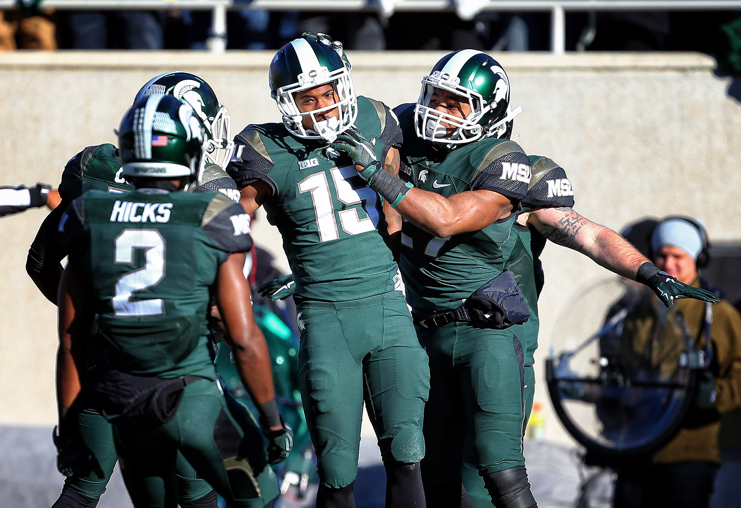 Nov 14, 2015; East Lansing, MI, USA; Michigan State Spartans cornerback Tyson Smith (15) and Michigan State Spartans cornerback Darian Hicks (2) celebrate defense stop during the 1st quarter of a game against the Maryland Terrapins at Spartan Stadium. Mandatory Credit: Mike Carter-USA TODAY Sports