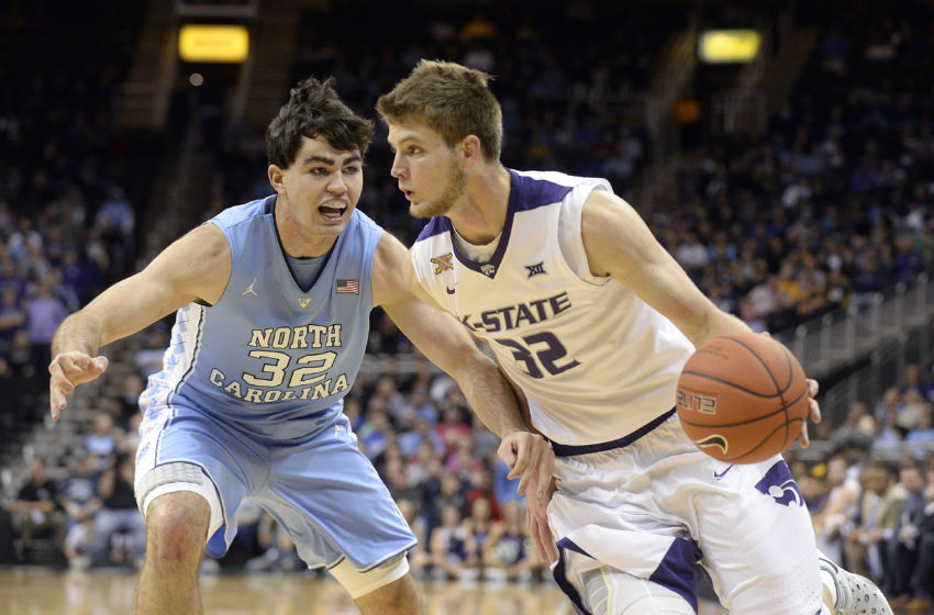 Nov 24, 2015; Kansas City, MO, USA; Kansas State Wildcats forward Dean Wade (32) drives to the basket against North Carolina Tar Heels forward Luke Maye (32) in the first half at Sprint Center. Mandatory Credit: John Rieger-USA TODAY Sports
