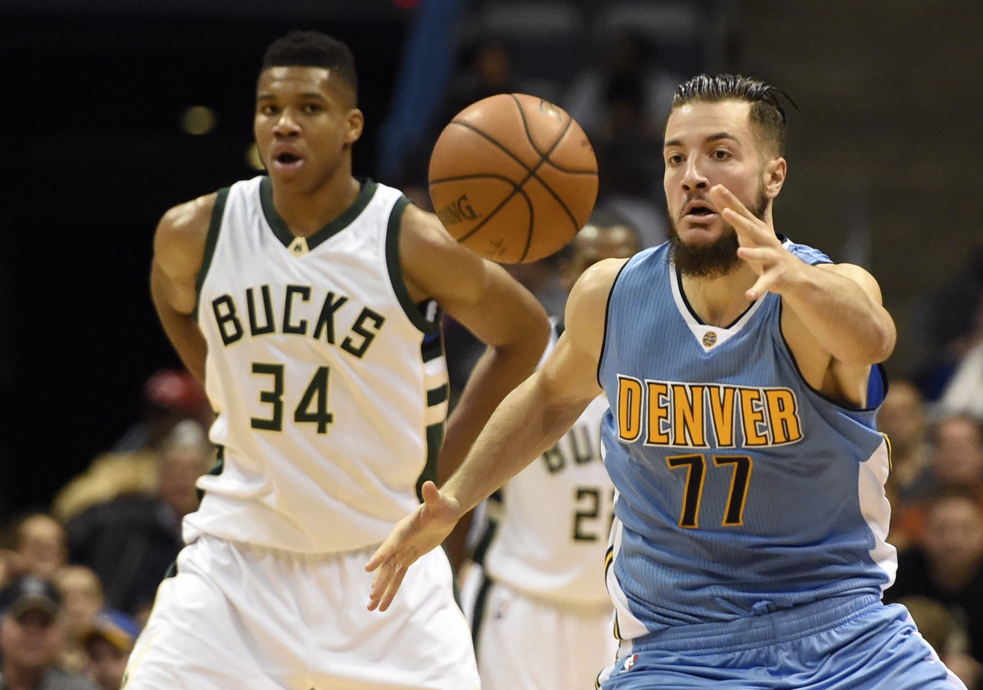 Nov 30, 2015; Milwaukee, WI, USA;  Denver Nuggets center Joffrey Lauvergne (77) grabs a loose ball in front of Milwaukee Bucks forward Giannis Antetokounmpo (34) in the third quarter at BMO Harris Bradley Center. Mandatory Credit: Benny Sieu-USA TODAY Sports