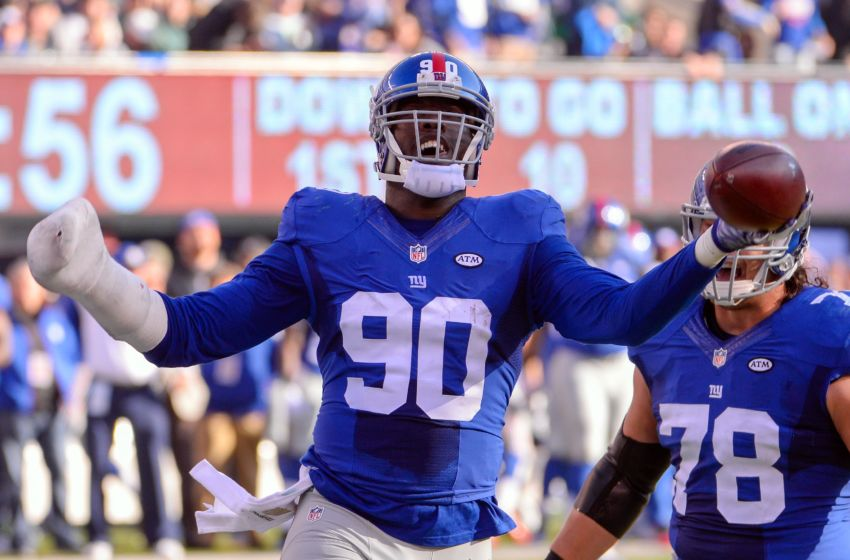 Dec 6, 2015; East Rutherford, NJ, USA; New York Giants defensive end Jason Pierre-Paul (90) celebrates after recovering a fumble during the first half against the New York Jets at MetLife Stadium. Mandatory Credit: Robert Deutsch-USA TODAY Sports