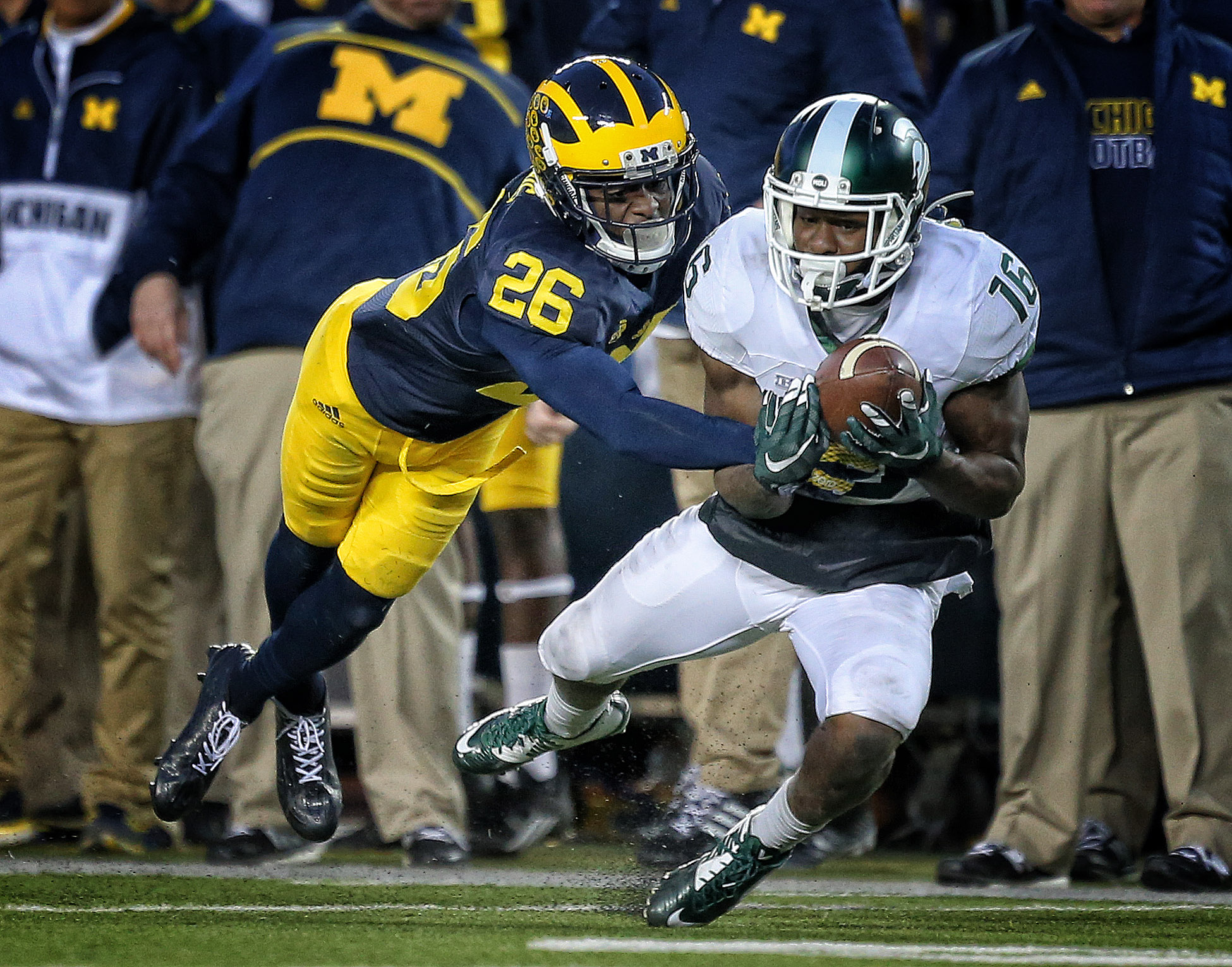 Oct 17, 2015; Ann Arbor, MI, USA; Michigan Wolverines cornerback Jourdan Lewis (26) defends against Michigan State Spartans wide receiver Aaron Burbridge (16) during the 2nd half of a game at Michigan Stadium. Mandatory Credit: Mike Carter-USA TODAY Sports