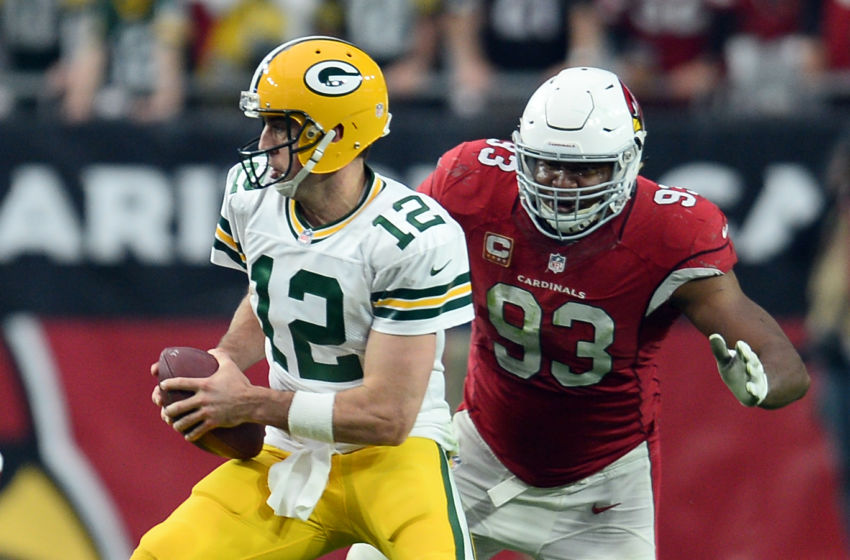 Dec 27, 2015; Glendale, AZ, USA; Arizona Cardinals defensive end Calais Campbell (93) pursues Green Bay Packers quarterback Aaron Rodgers (12) during the first half at University of Phoenix Stadium. Mandatory Credit: Joe Camporeale-USA TODAY Sports