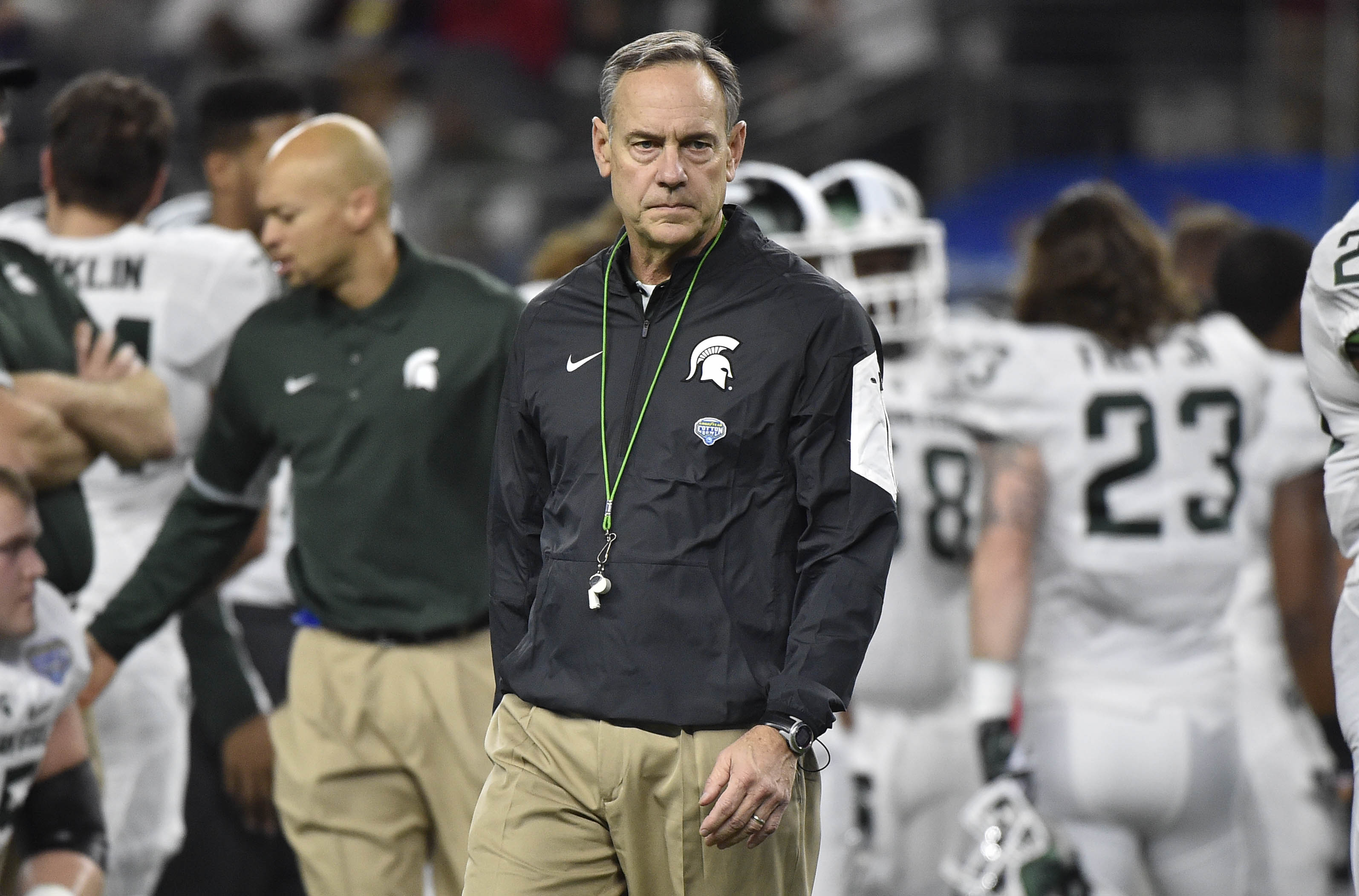 Dec 31, 2015; Arlington, TX, USA; Michigan State Spartans head coach Mark Dantonio looks on during warm-ups prior to the game Alabama Crimson Tide in the 2015 CFP semifinal at the Cotton Bowl at AT&T Stadium. Mandatory Credit: Jerome Miron-USA TODAY Sports