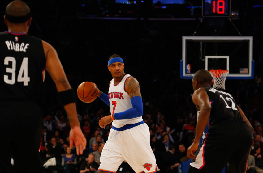 Jan 22, 2016; New York, NY, USA; New York Knicks forward Carmelo Anthony (7) handles the ball against Los Angeles Clippers forward Paul Pierce (34) and Los Angeles Clippers forward Luc Richard Mbah a Moute (12)  during second half at Madison Square Garden. Mandatory Credit: Noah K. Murray-USA TODAY Sports