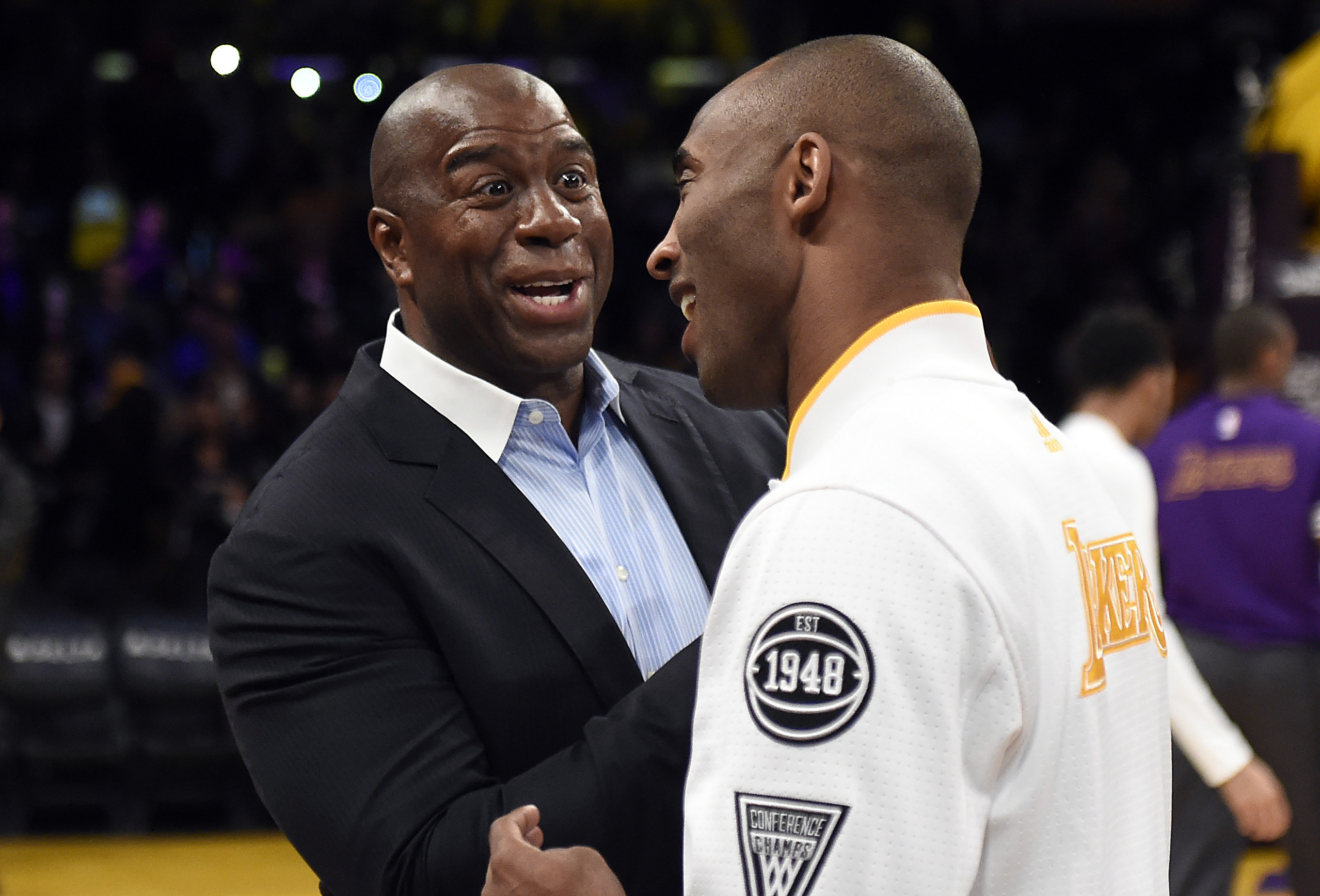 Jan 31, 2016; Los Angeles, CA, USA; Los Angeles Lakers forward Kobe Bryant (24) and Los Angeles Lakers former player Magic Johnson talk before the game against the Charlotte Hornets at Staples Center. Mandatory Credit: Richard Mackson-USA TODAY Sports