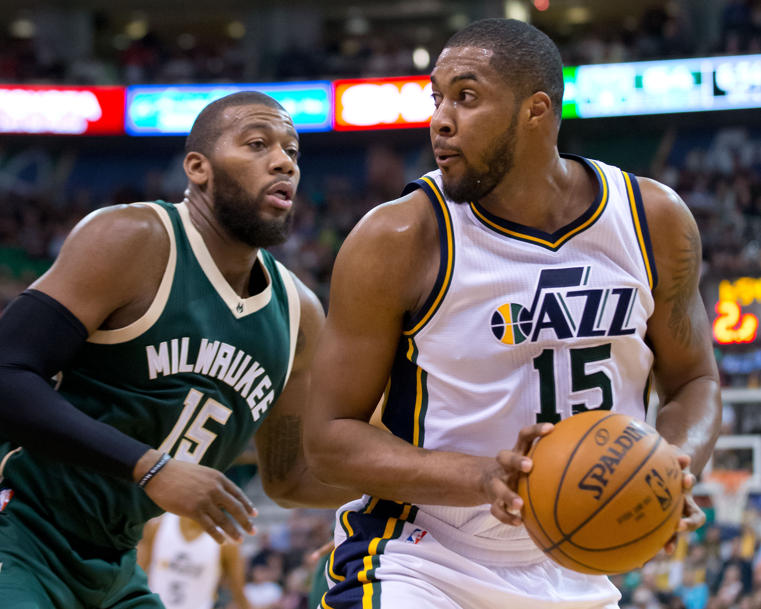 Feb 5, 2016; Salt Lake City, UT, USA; Milwaukee Bucks center Greg Monroe (15) defends against Utah Jazz forward Derrick Favors (15) during the second half at Vivint Smart Home Arena. The Jazz won 84-81. Mandatory Credit: Russ Isabella-USA TODAY Sports