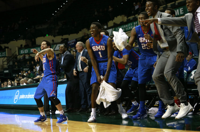 Feb 7, 2016; Tampa, FL, USA; Southern Methodist Mustangs guard Nic Moore (11) and guard Shake Milton (1) and the bench celebrates after a Mustangs basket during the second half against the South Florida Bulls at USF Sun Dome. SMU defeated South Florida 93-59. Mandatory Credit: Kim Klement-USA TODAY Sports