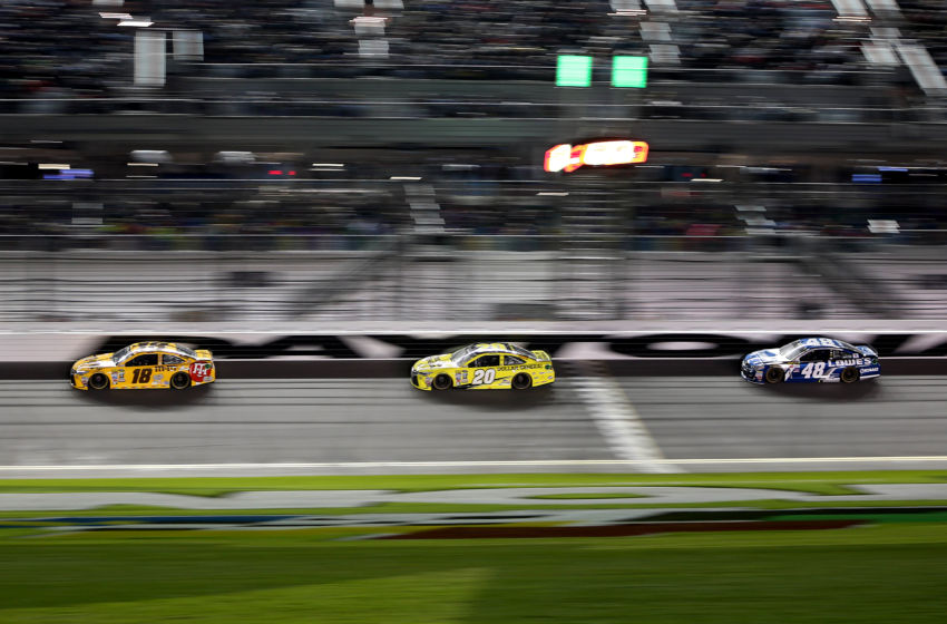 Feb 18, 2016; Daytona Beach, FL, USA; NASCAR Sprint Cup Series driver Kyle Busch (18), NASCAR Sprint Cup Series driver Matt Kenseth (20) and NASCAR Sprint Cup Series driver Jimmie Johnson (48) during the Cam-Am Duels at Daytona race two at Daytona International Speedway. Mandatory Credit: Peter Casey-USA TODAY Sports