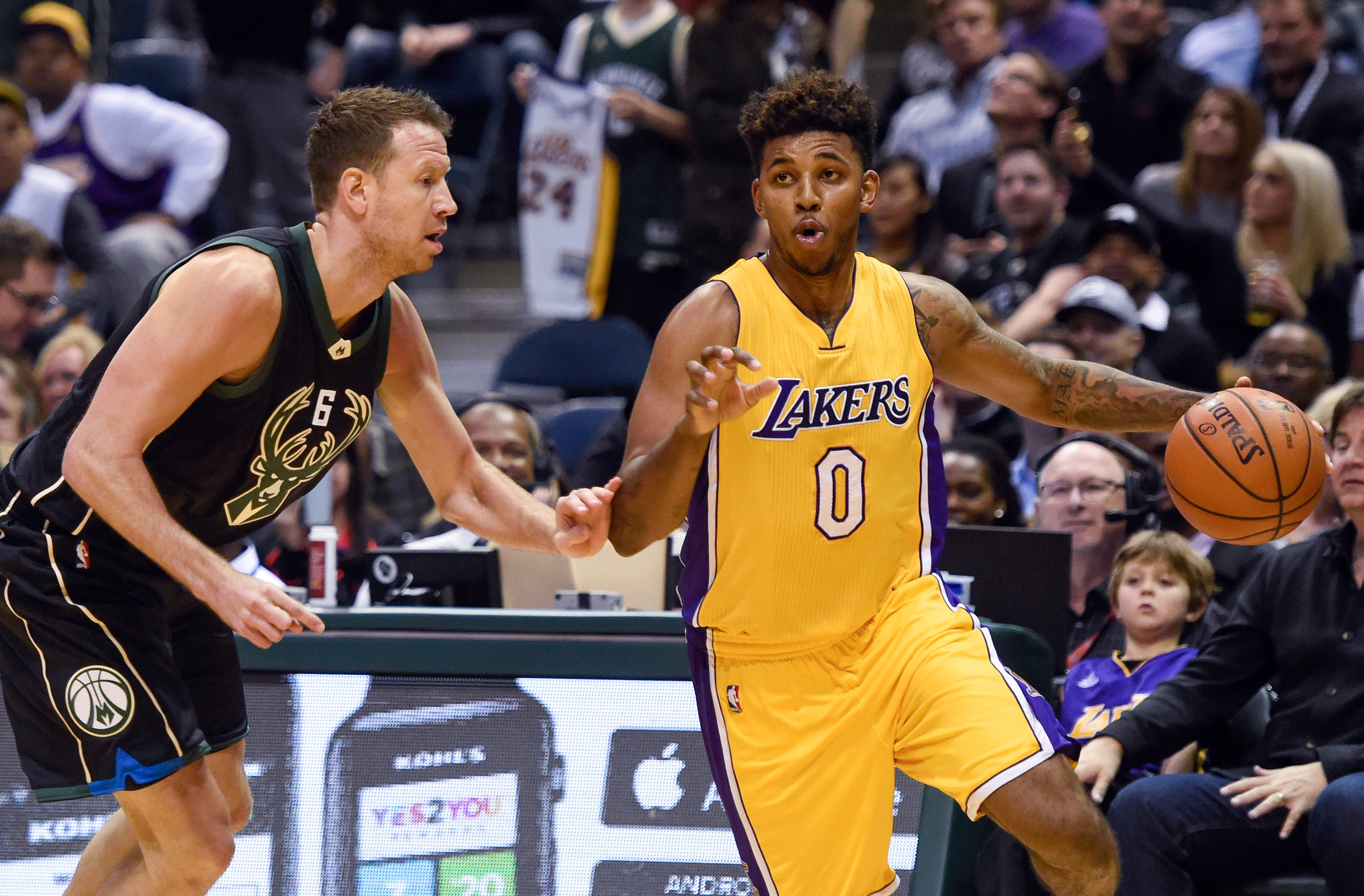 Feb 22, 2016; Milwaukee, WI, USA; Milwaukee Bucks forward Steve Novak (6) guards Los Angeles Lakers forward Nick Young (0) in the fourth quarter at BMO Harris Bradley Center. The Bucks beat the Lakers 108-101. Mandatory Credit: Benny Sieu-USA TODAY Sports