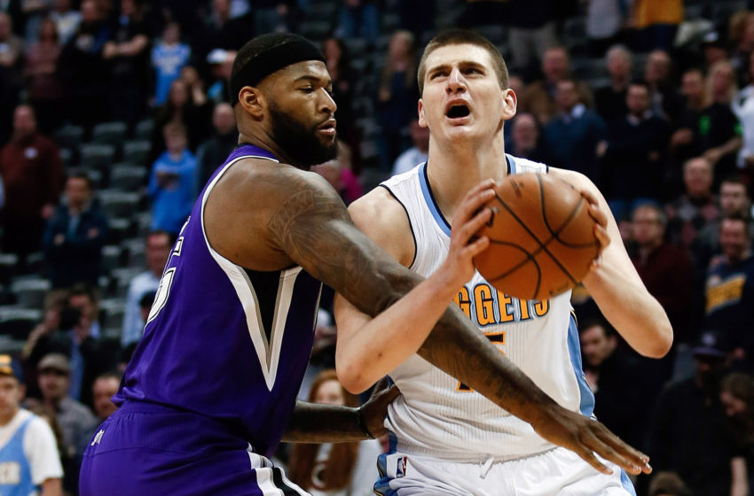 Feb 23, 2016; Denver, CO, USA; Sacramento Kings center DeMarcus Cousins (15) fouls Denver Nuggets center Nikola Jokic (15) in the first quarter at Pepsi Center. Mandatory Credit: Isaiah J. Downing-USA TODAY Sports