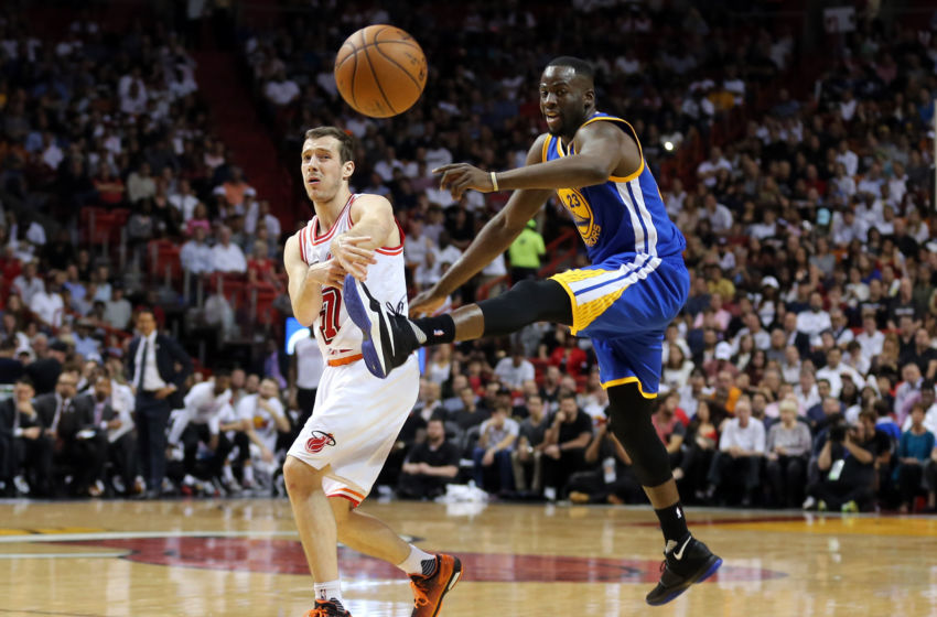Feb 24, 2016; Miami, FL, USA; Miami Heat guard Goran Dragic (7) passes the ball as Golden State Warriors forward Draymond Green (23) attempts to kick the ball during the second half at American Airlines Arena. Mandatory Credit: Steve Mitchell-USA TODAY Sports
