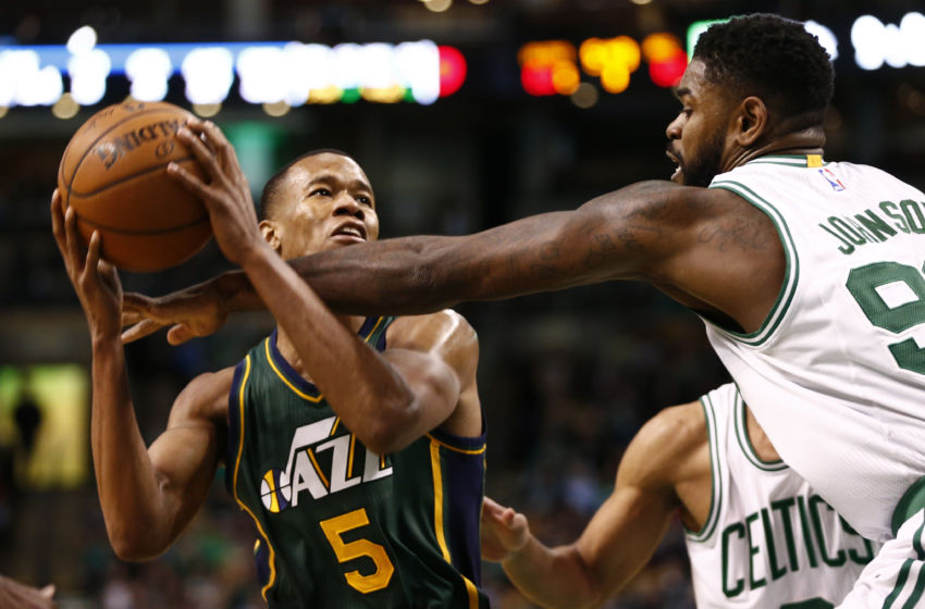 Feb 29, 2016; Boston, MA, USA; Utah Jazz guard Rodney Hood (5) is fouled by Boston Celtics forward Amir Johnson (right) during the second half at TD Garden. Mandatory Credit: Mark L. Baer-USA TODAY Sports