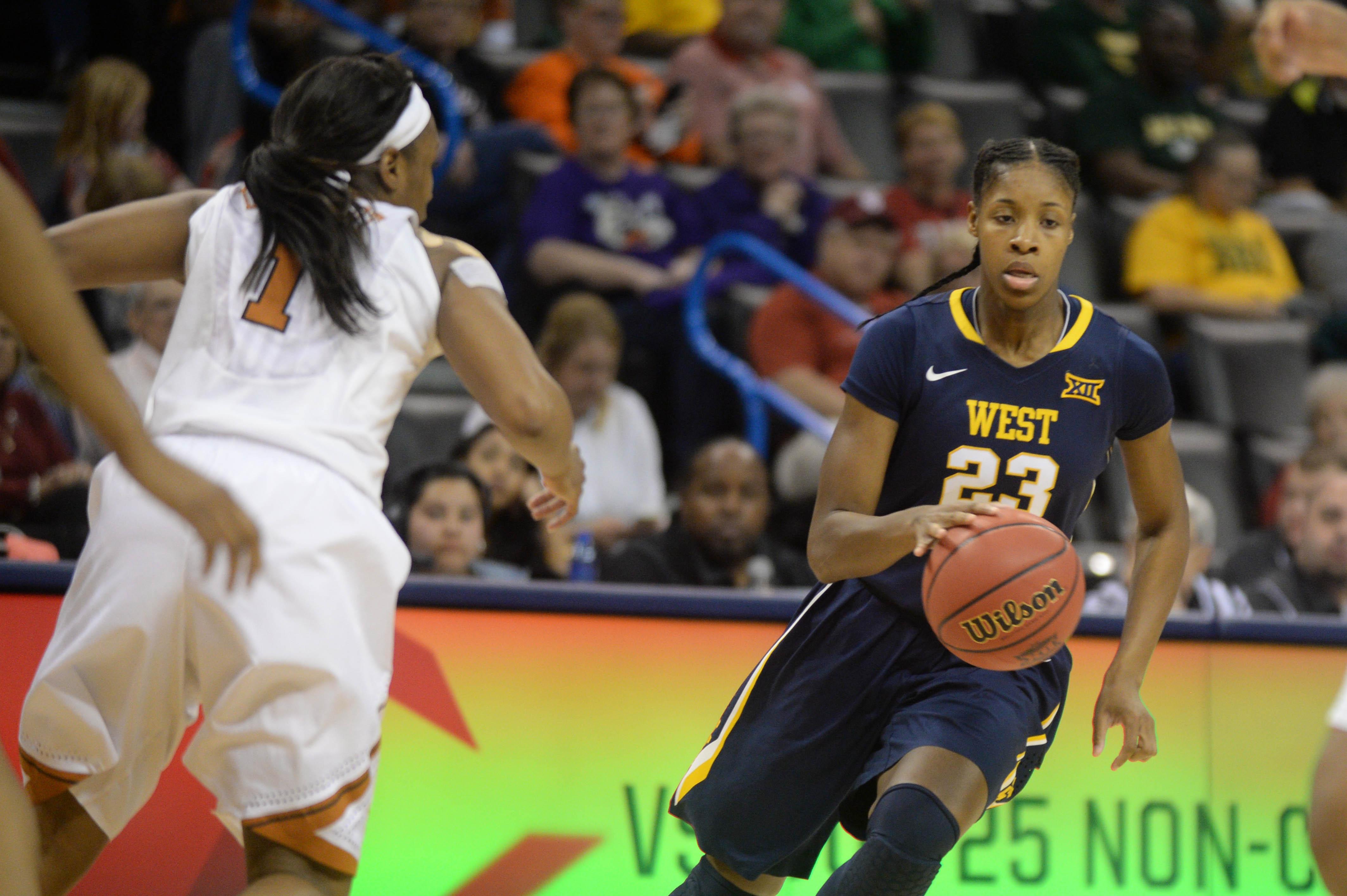 9162531-ncaa-womens-basketball-big-12-conference-tournament-texas-vs-west-virginia