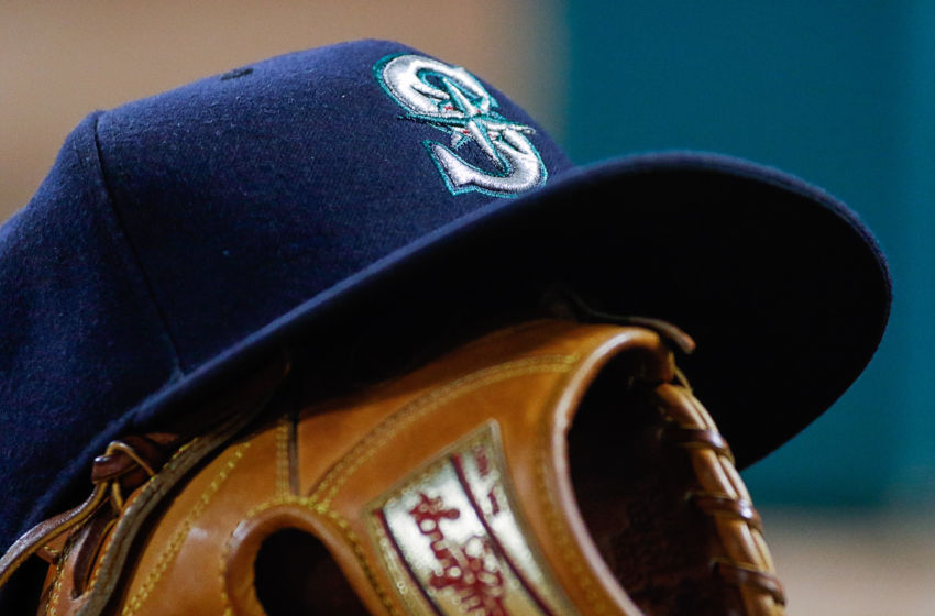 Jun 4, 2016; Arlington, TX, USA; A Seattle Mariners hat sits on top a mitt during a game against the Texas Rangers at Globe Life Park in Arlington. Rangers won 10-4. Mandatory Credit: Ray Carlin-USA TODAY Sports