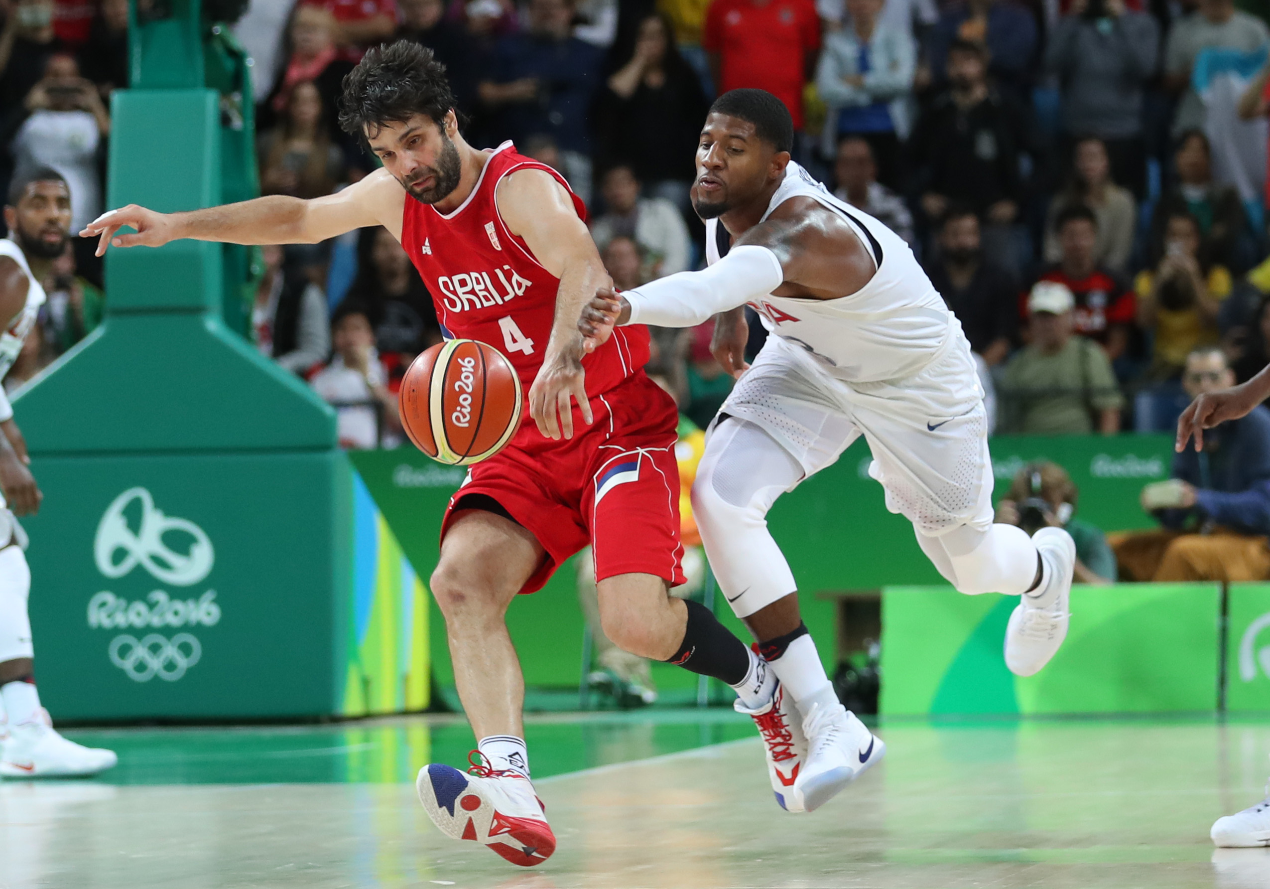 9453684-olympics-basketball-mens-team-preliminary-round-usa-vs-srb